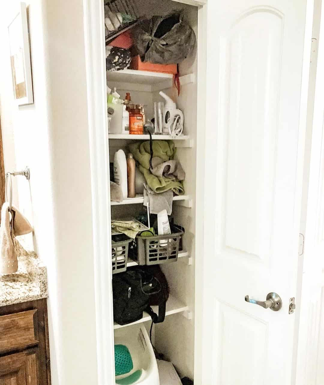 How to Organize a Linen Closet: 5 Essential Steps featured by top US life and style blog, Glamorous Versatility: before