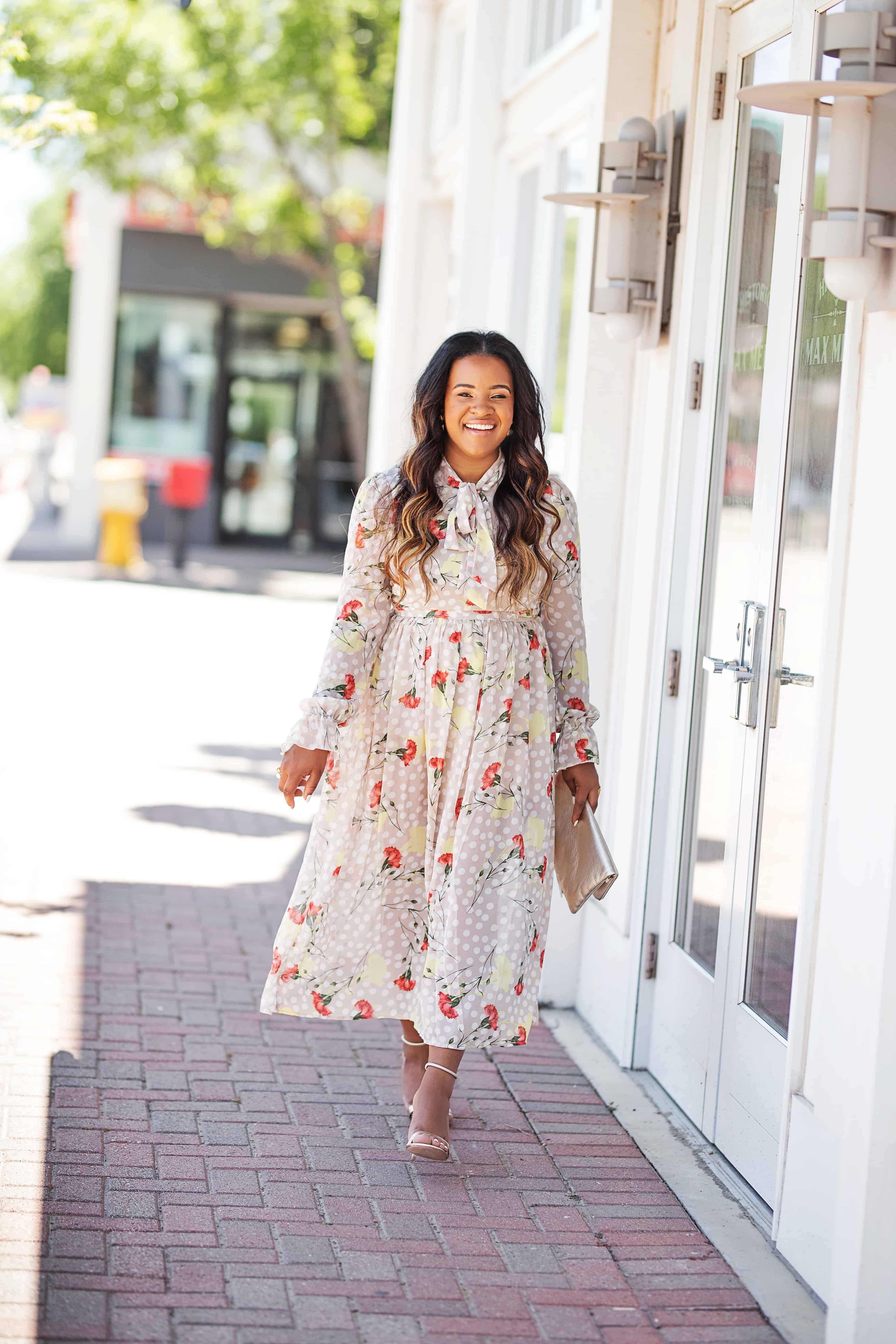 20 Cute Wedding Guest Dresses Under $50 featured by top US fashion blog, Glamorous Versatility: image of a woman wearing a floral wedding guest dress from Pretty Little Thing