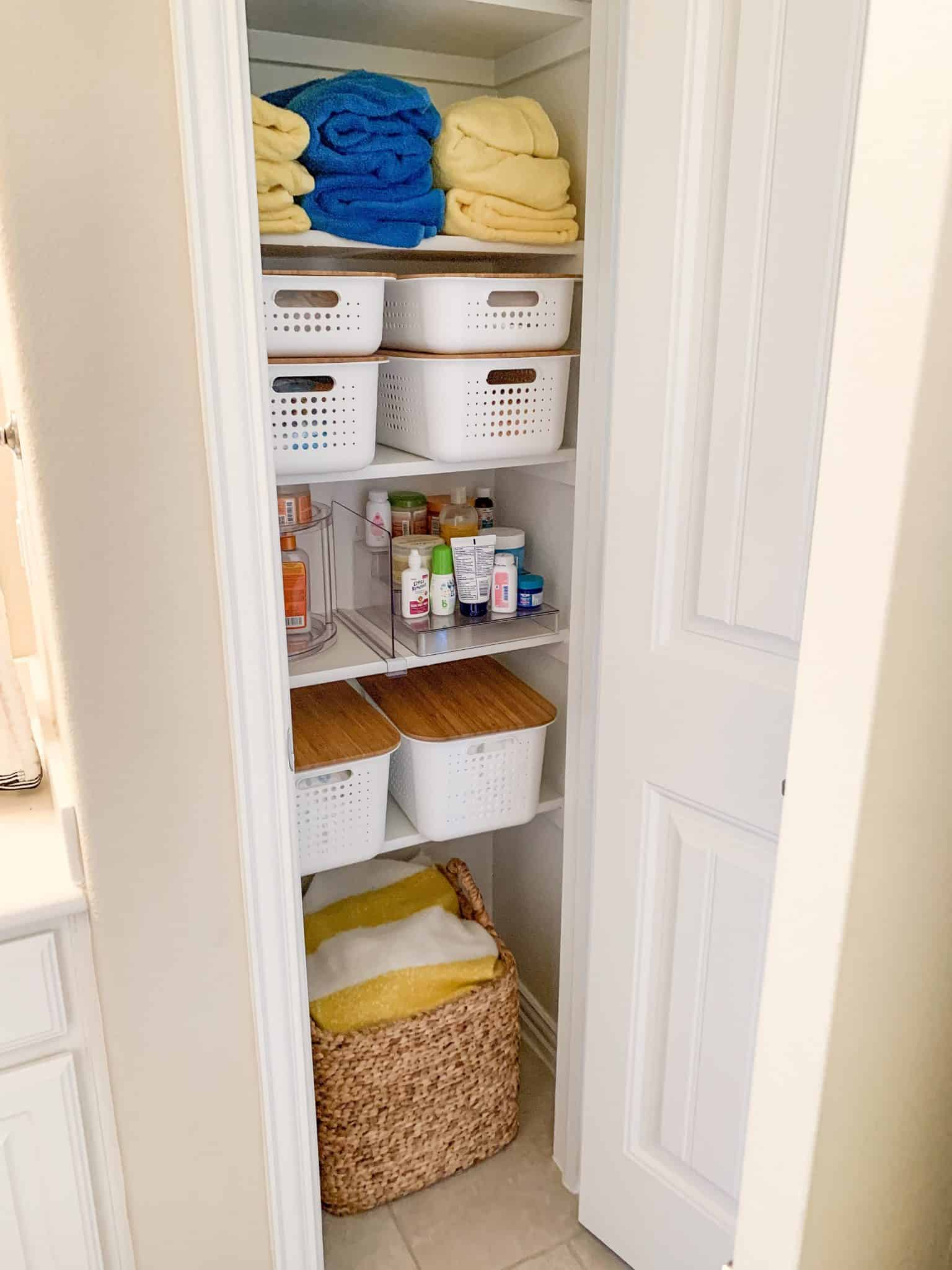 Top Home Organization Projects of 2019 by popular Dallas life and style blog, Glamorous Versatility: image of an organized linen closet.