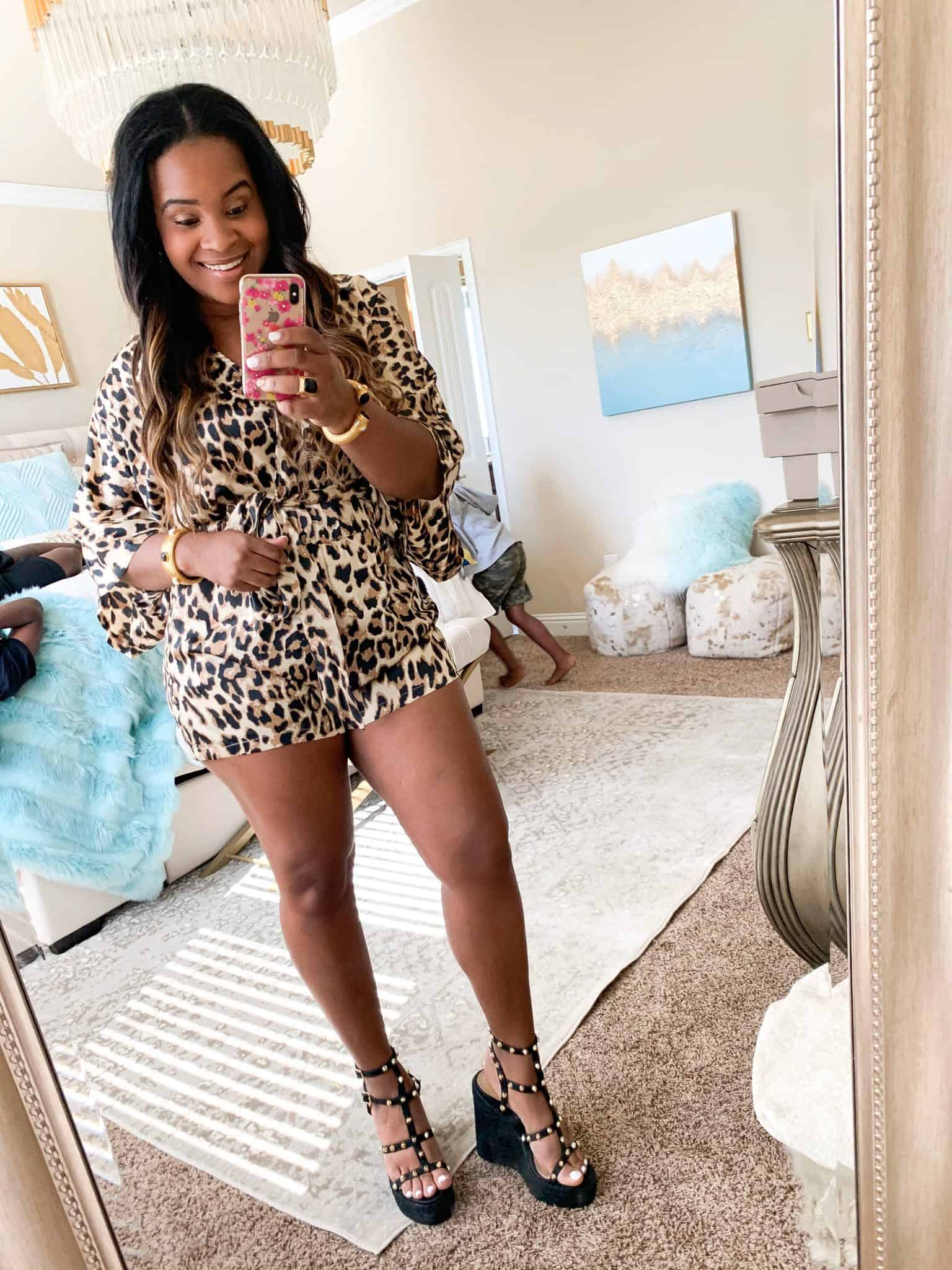 Pink Lily Boutique Try On for May, featured by top US fashion blog, Glamorous Versatility: image of a woman wearing a Pink Lily leopard romper