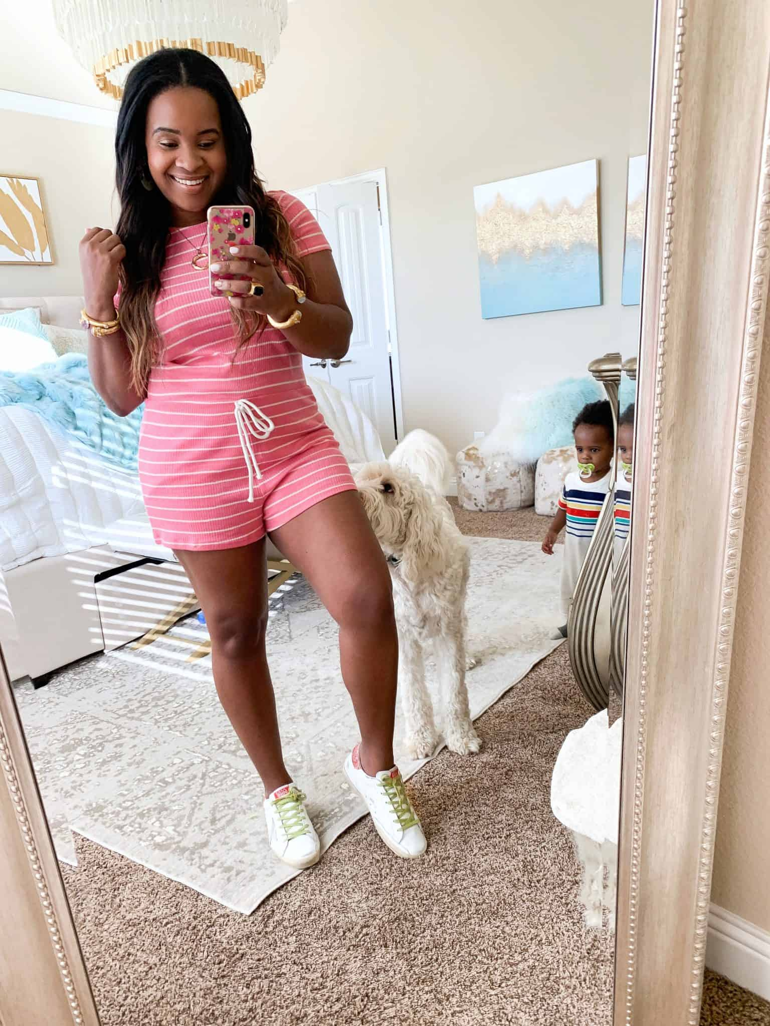 Pink Lily Boutique Try On for May, featured by top US fashion blog, Glamorous Versatility: image of a woman wearing a Pink Lily striped pink romper