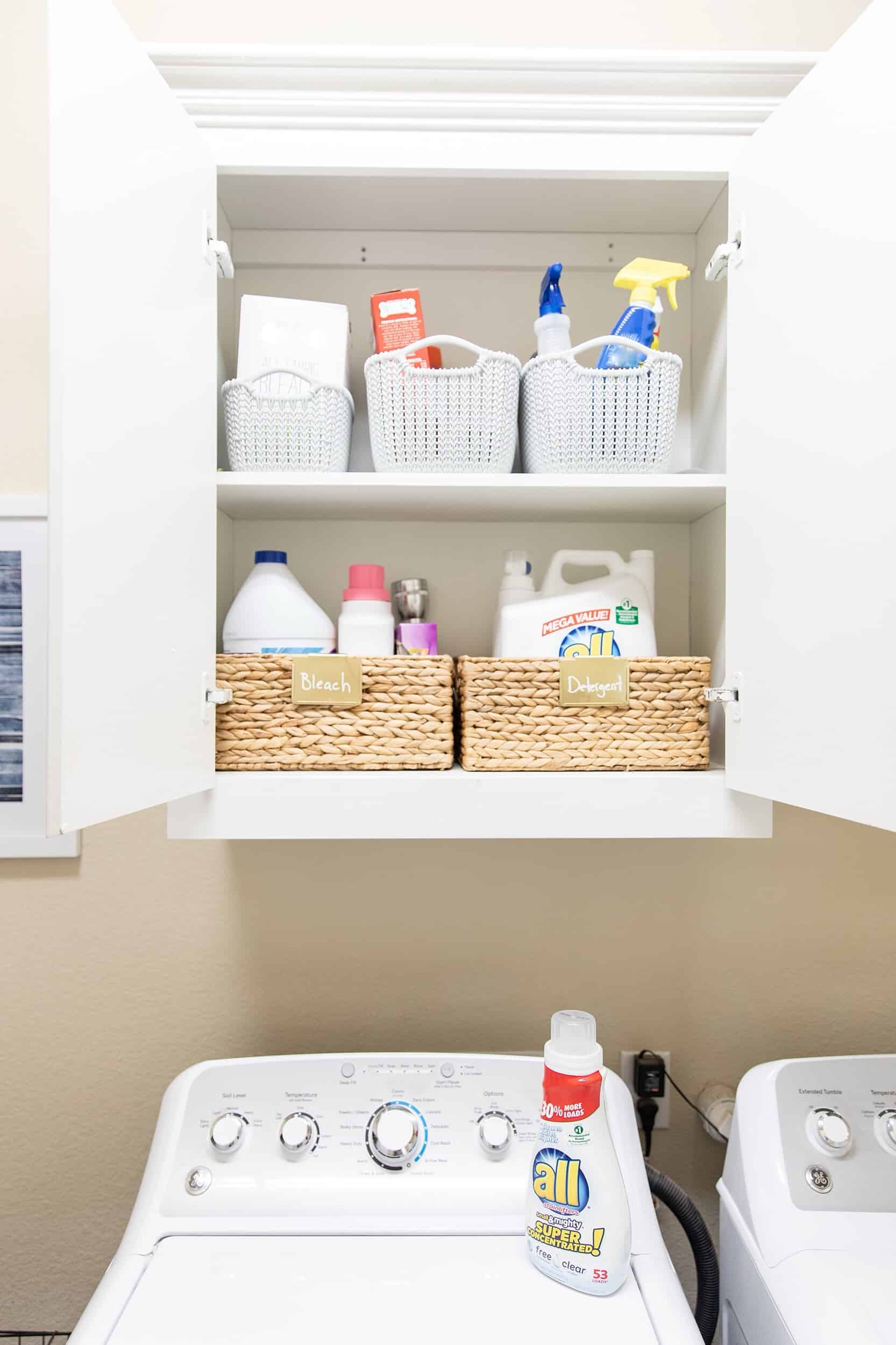 Top Home Organization Projects of 2019 by popular Dallas life and style blog, Glamorous Versatility: image of of an organized laundry room cupboard.