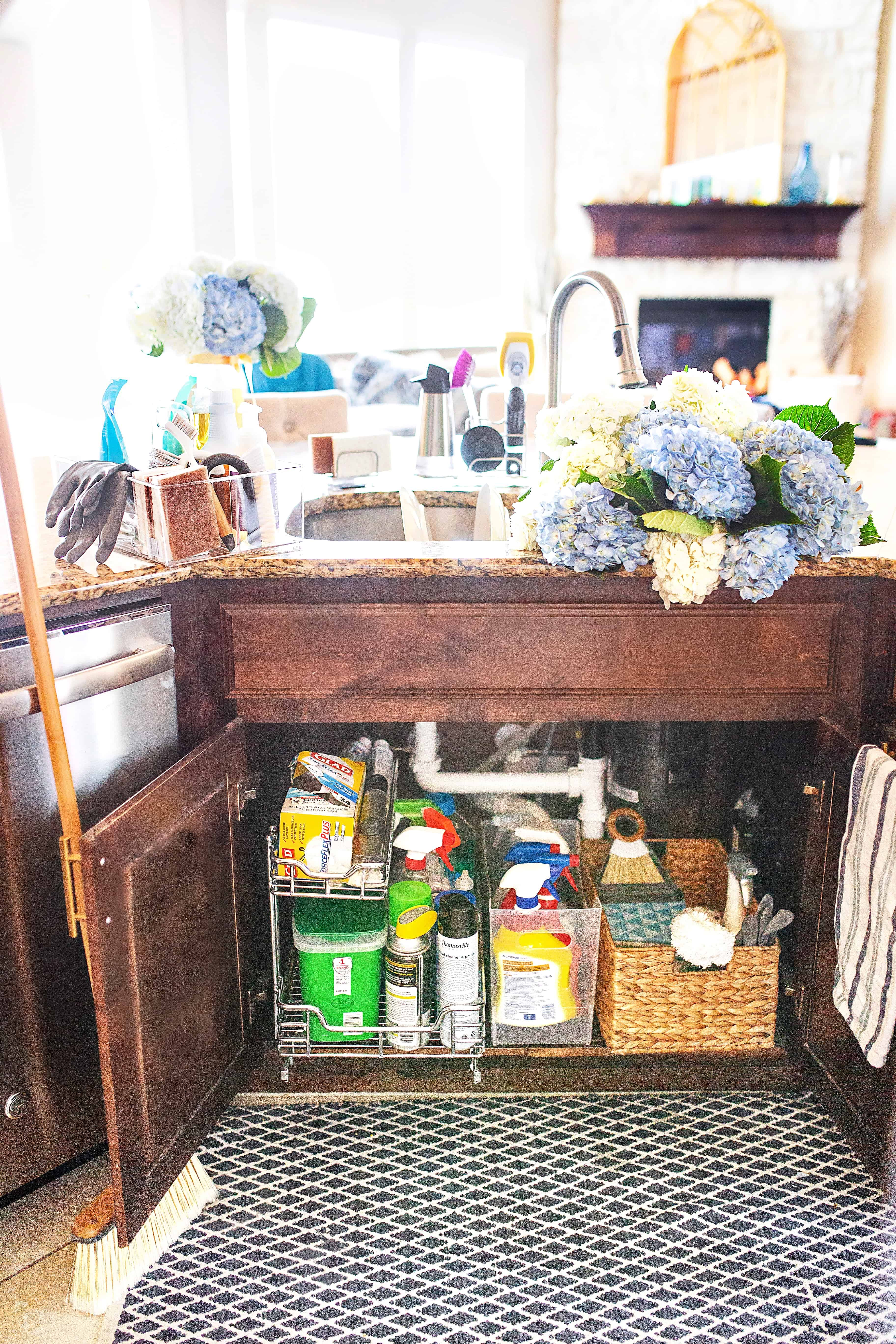 Top Home Organization Projects of 2019 by popular Dallas life and style blog, Glamorous Versatility: image of an organized under the sink cupboard.