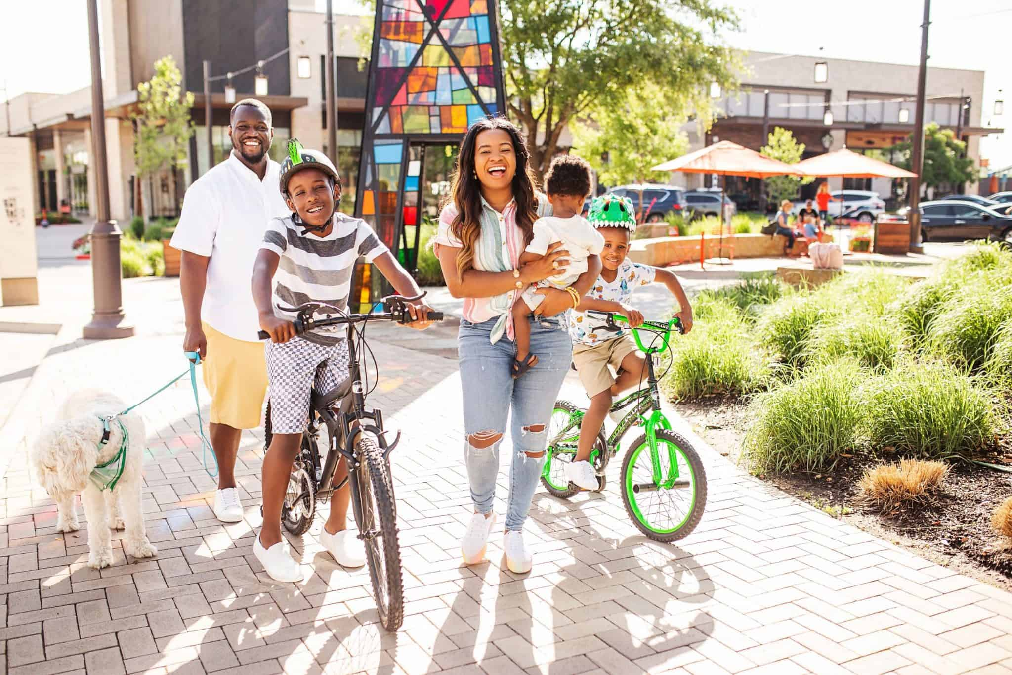 Top 40 Fun Summer Activities for Kids featured by top US life and style blog, Glamorous Versatility: image of a family going on a bike ride