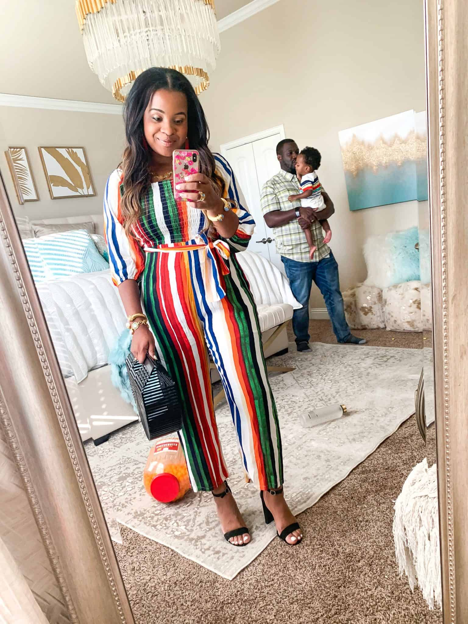 Red Dress Boutique Try-On featured by top US fashion blog, Glamorous Versatility: image of a woman wearing a Red Dress Boutique rainbow stripes jumpsuit