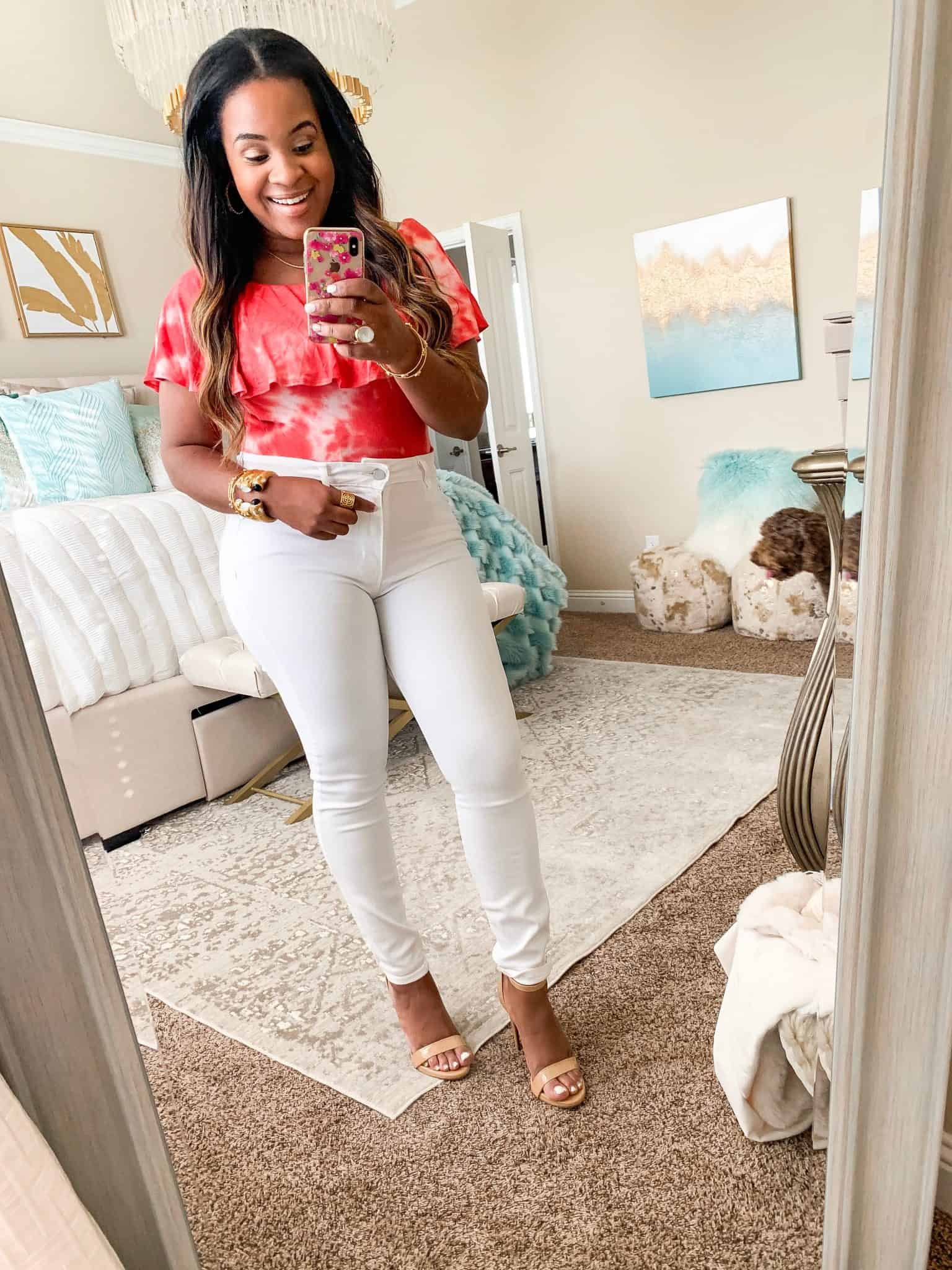 Red Dress Boutique summer favorites featured by top US fashion blog, Glamorous Versatility: image of a woman wearing a red bodysuit and white skinny jeans