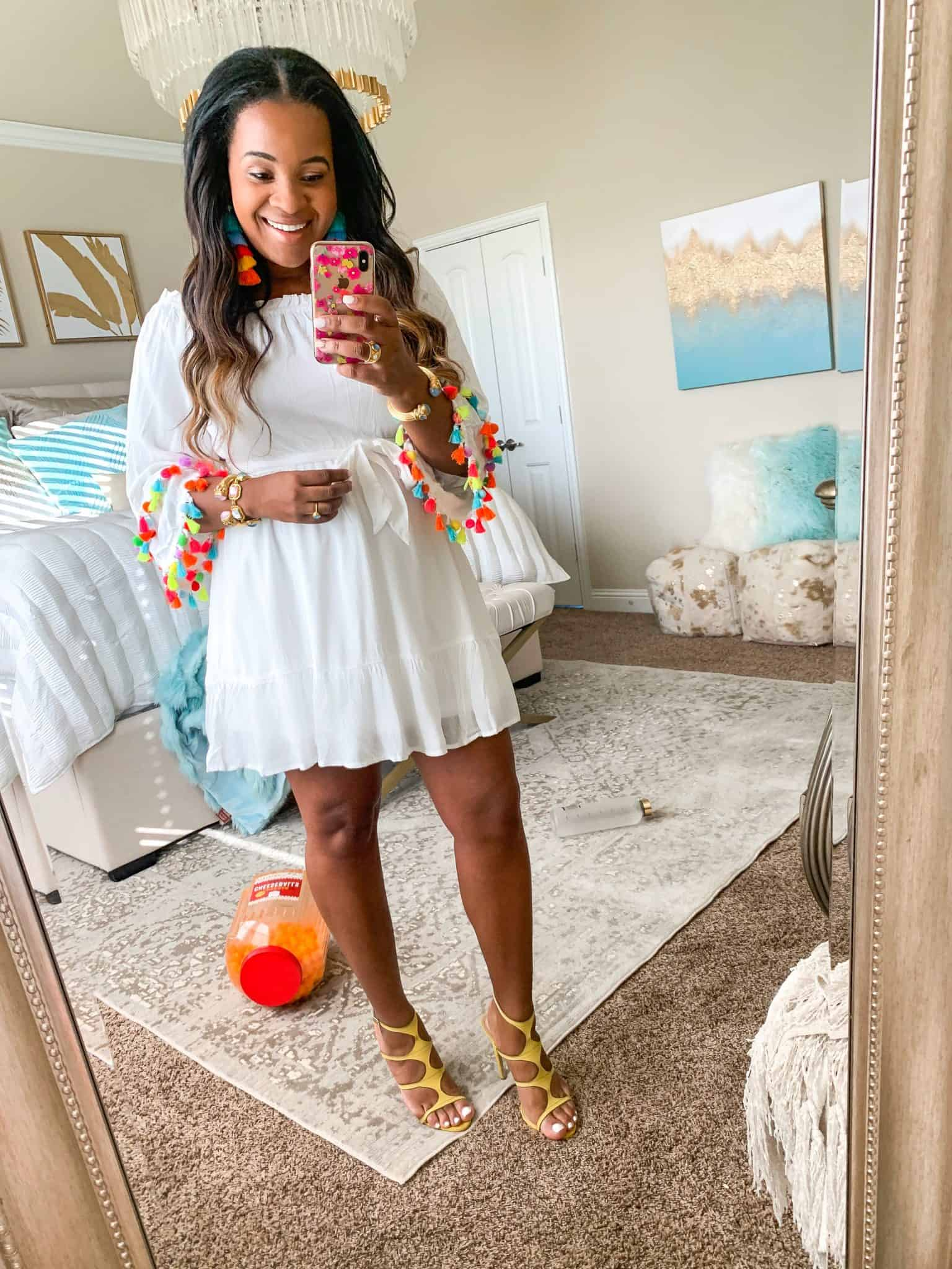 Red Dress Boutique Try-On featured by top US fashion blog, Glamorous Versatility: image of a woman wearing a Red Dress Boutique off the shoulder pom pom dress