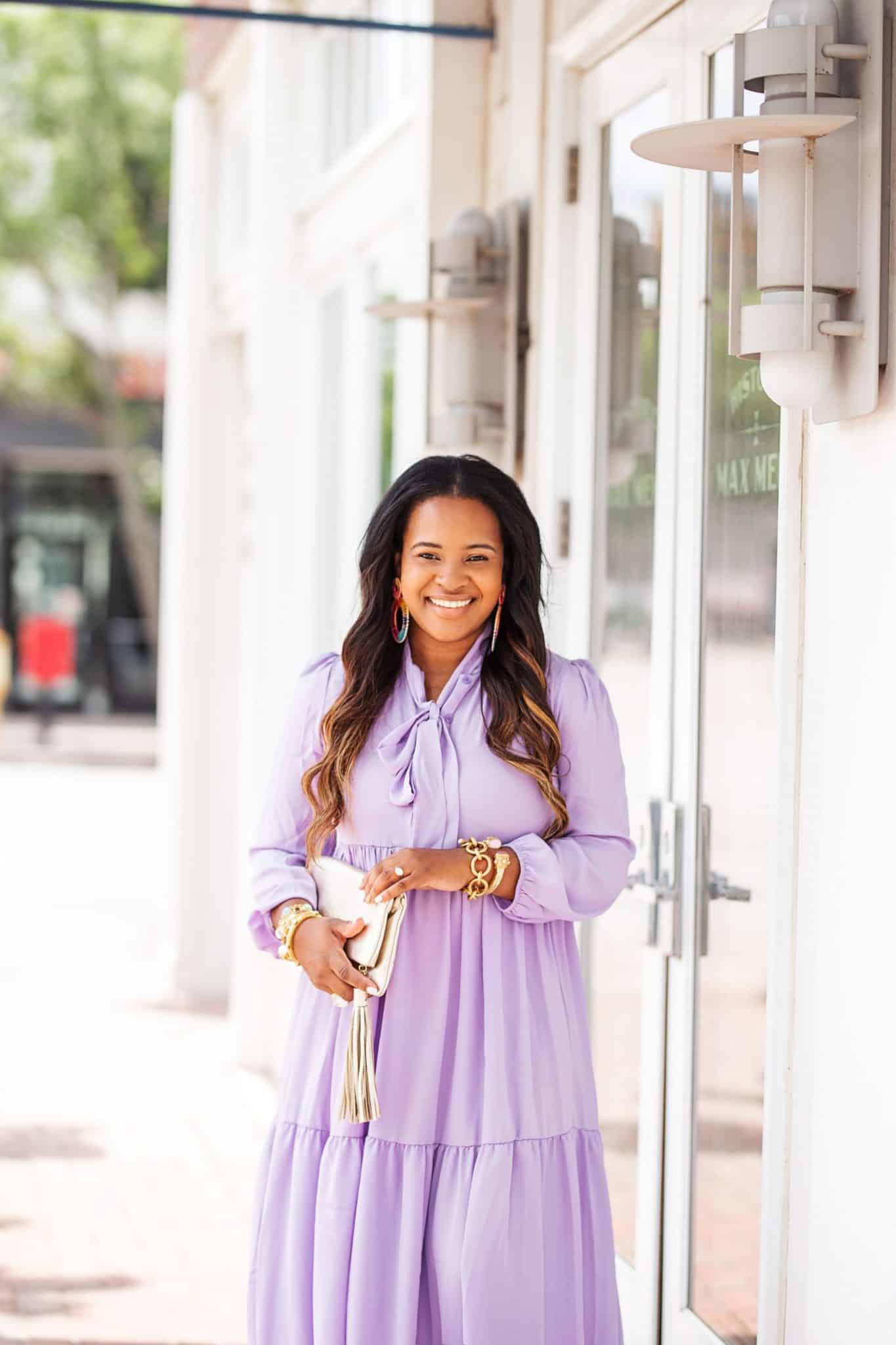 Affordable purple clothing featured by top US fashion blog, Glamorous Versatility: image of a woman wearing a Boohoo oversized purple dress.