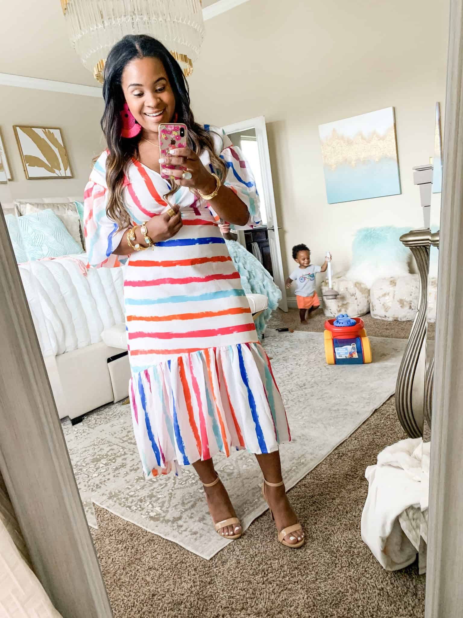 Red Dress Boutique summer favorites featured by top US fashion blog, Glamorous Versatility: image of a woman wearing a rainbow striped maxi dress
