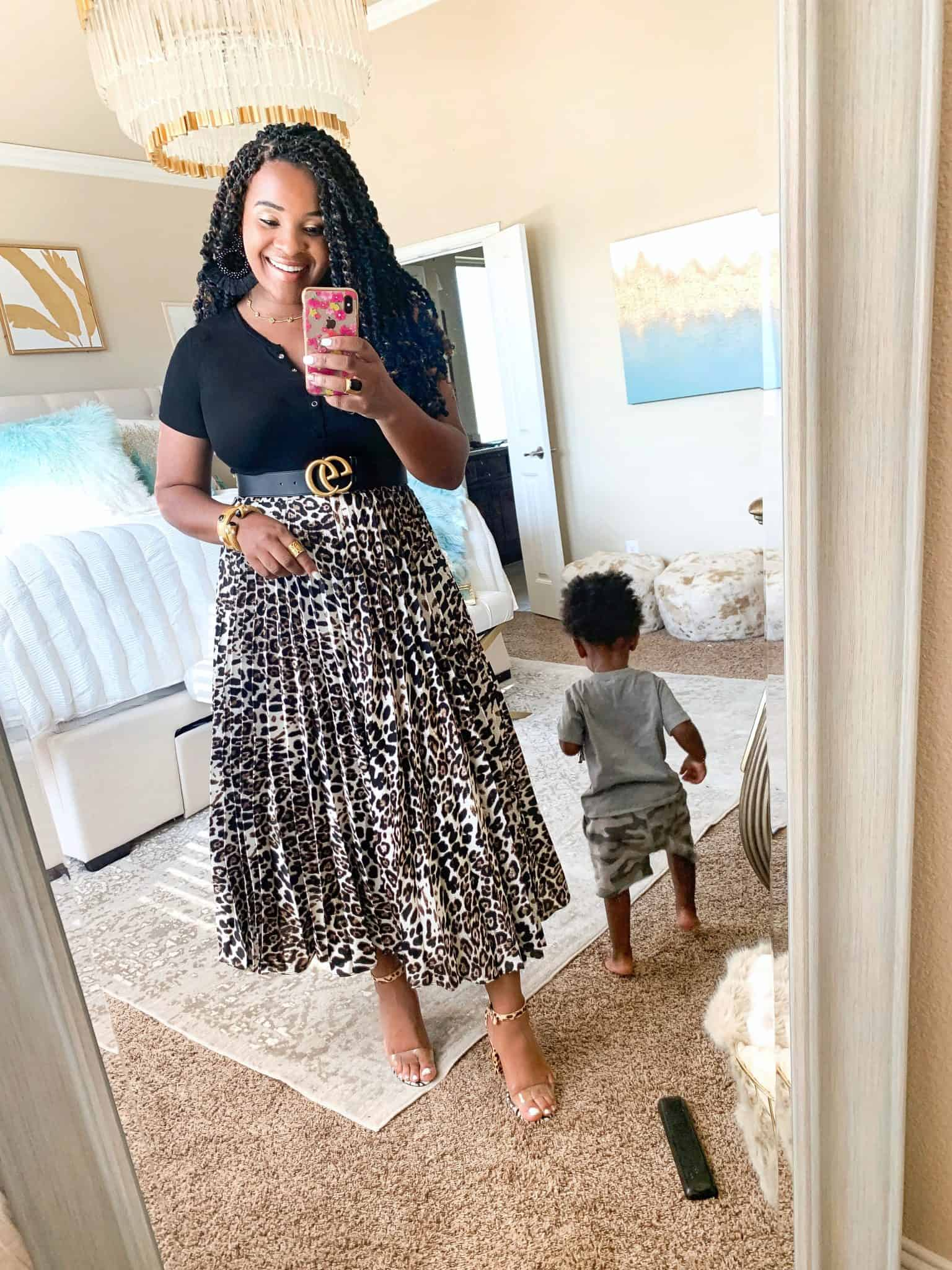 Leopard print trend featured by top US fashion blog, Glamorous Versatility: image of a woman wearing a Red Dress Boutique leopard print pleated maxi skirt