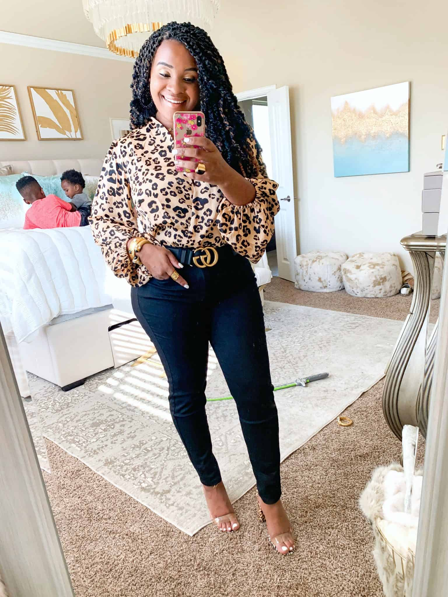 Leopard print trend featured by top US fashion blog, Glamorous Versatility: image of a woman wearing a Red Dress Boutique leopard print bodysuit