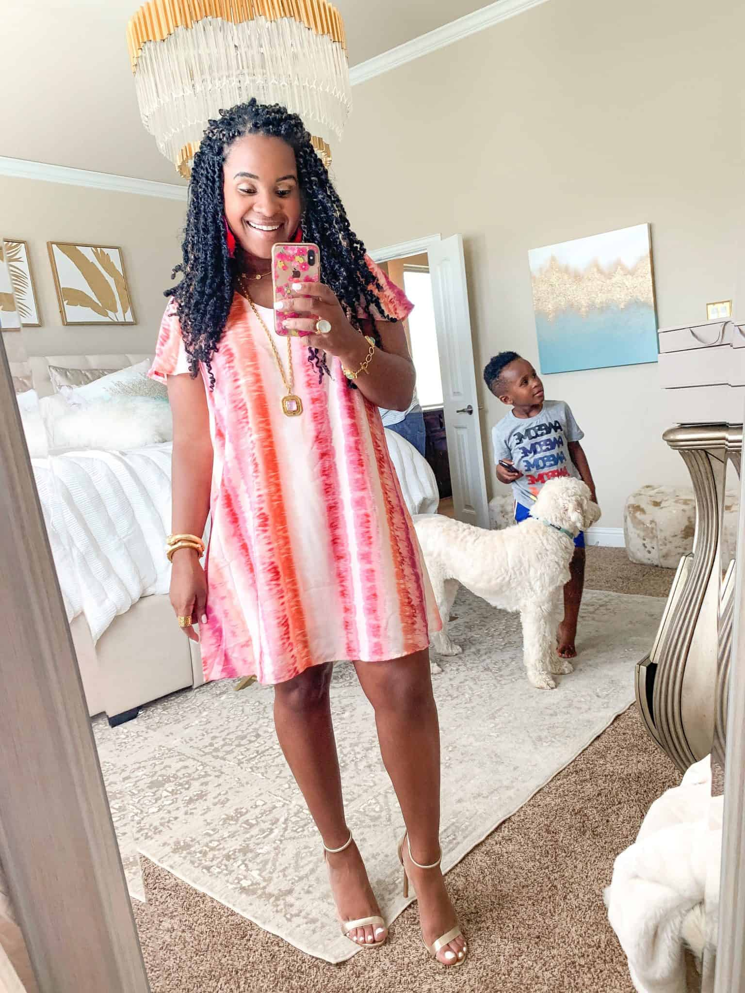 Pink Lily Boutique Favorites Under $50 featured by top US fashion blog, Glamorous Versatility: image of a woman wearing a Pink Lily pink printed dress