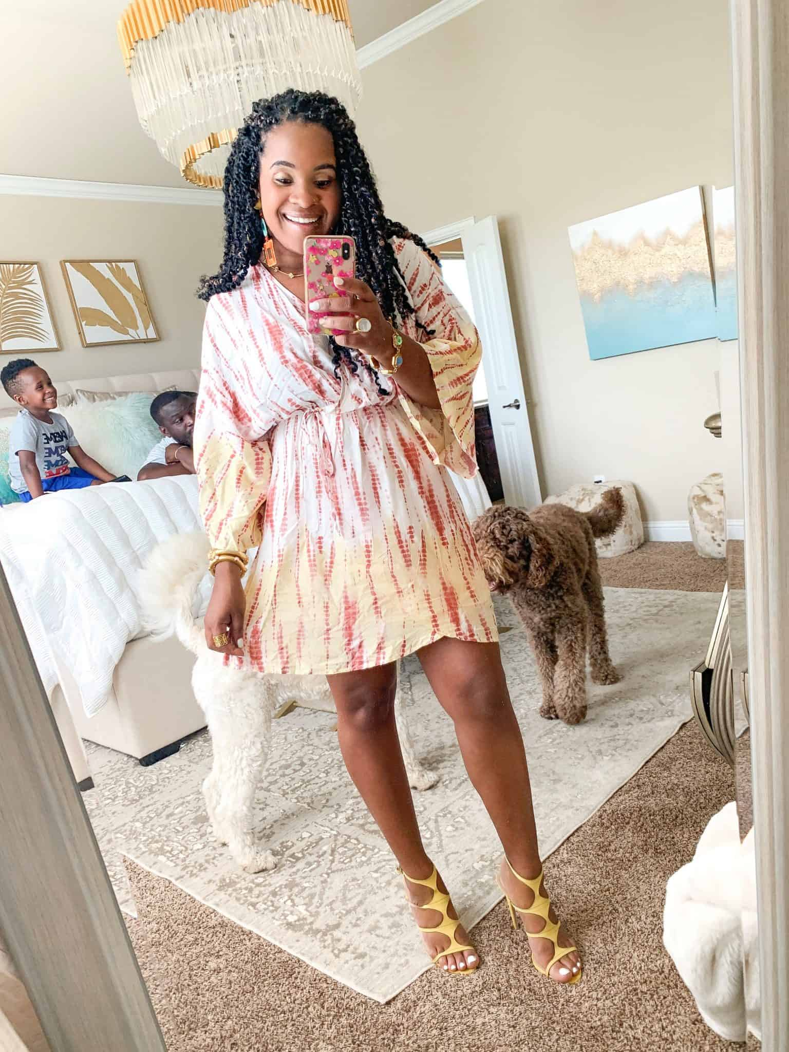 Pink Lily Boutique Favorites Under $50 featured by top US fashion blog, Glamorous Versatility: image of a woman wearing a Pink Lily tie dye dress