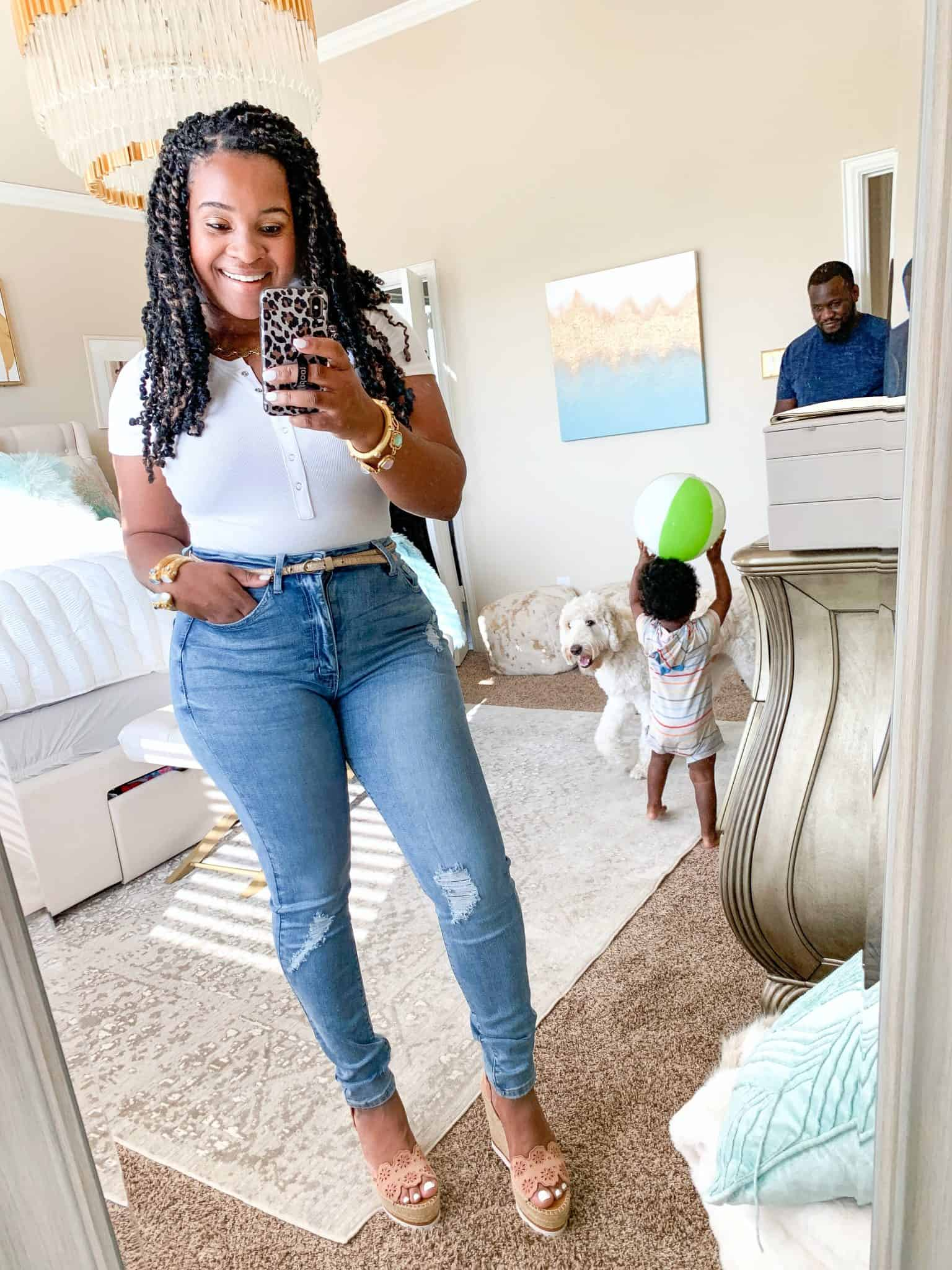 How To Wear White Before & After Labor Day by popular Dallas fashion blog, Glamorous Versatility: image of a woman wearing Red Dress boutique Have We Met Light Wash Distressed Curvy Skinny Jeans and Make It Up White Bodysuit.