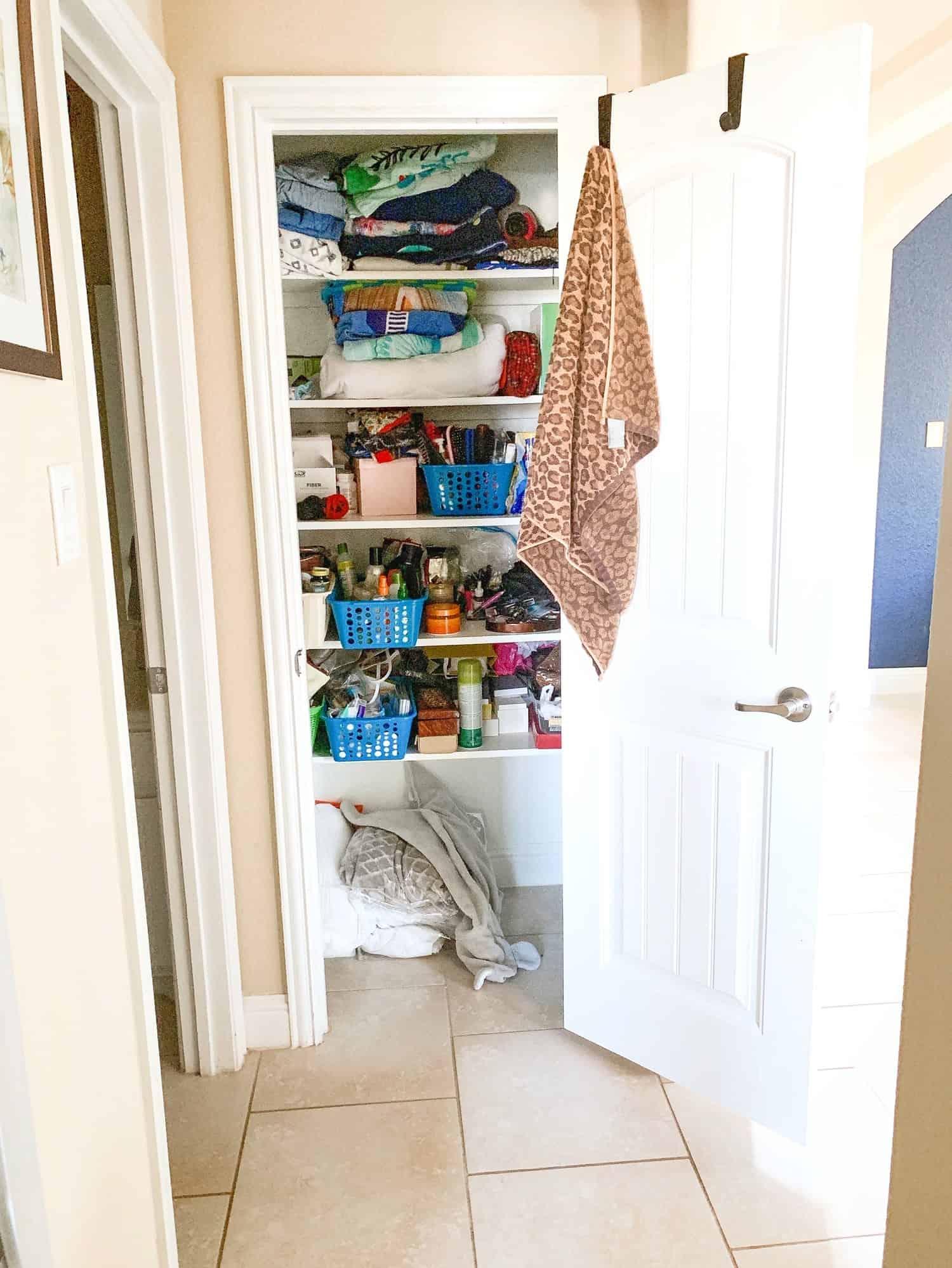 Super useful Bathroom Closet Organization Ideas featured by top US lifestyle blog, Glamorous Versatility