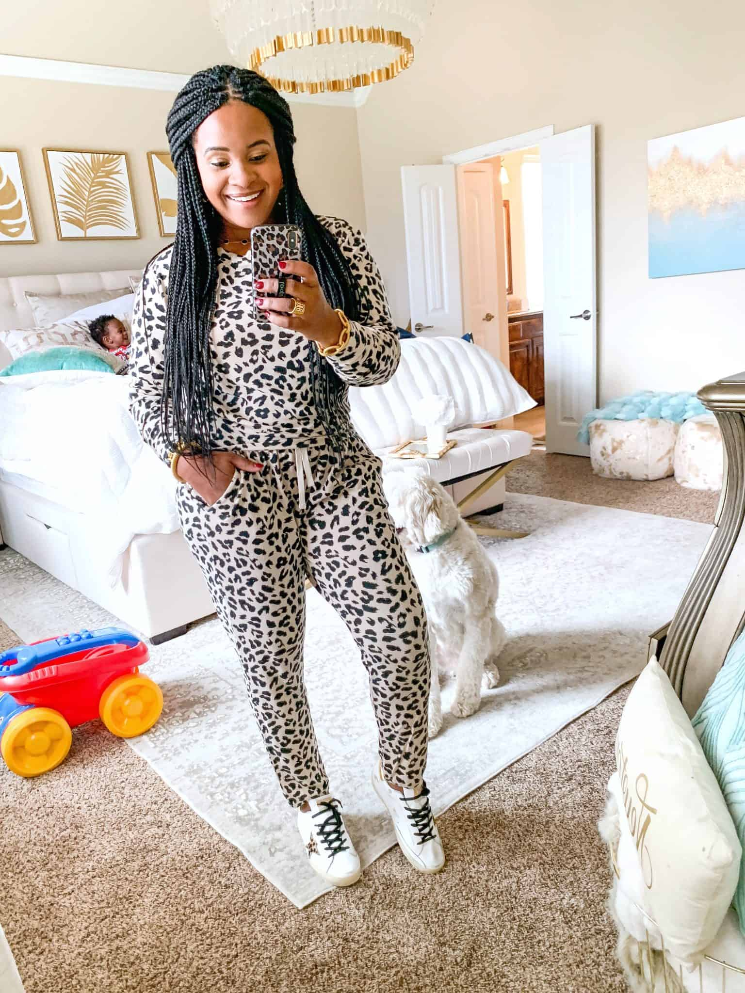 Red Dress Boutique Try On Fall 2019 by popular US fashion blog, Glamorous Versatility: image of a woman wearing a Red Dress Boutique Wildly Popular Leopard Pullover BB DAKOTA and In With The Crowd Leopard Joggers BB DAKOTA.