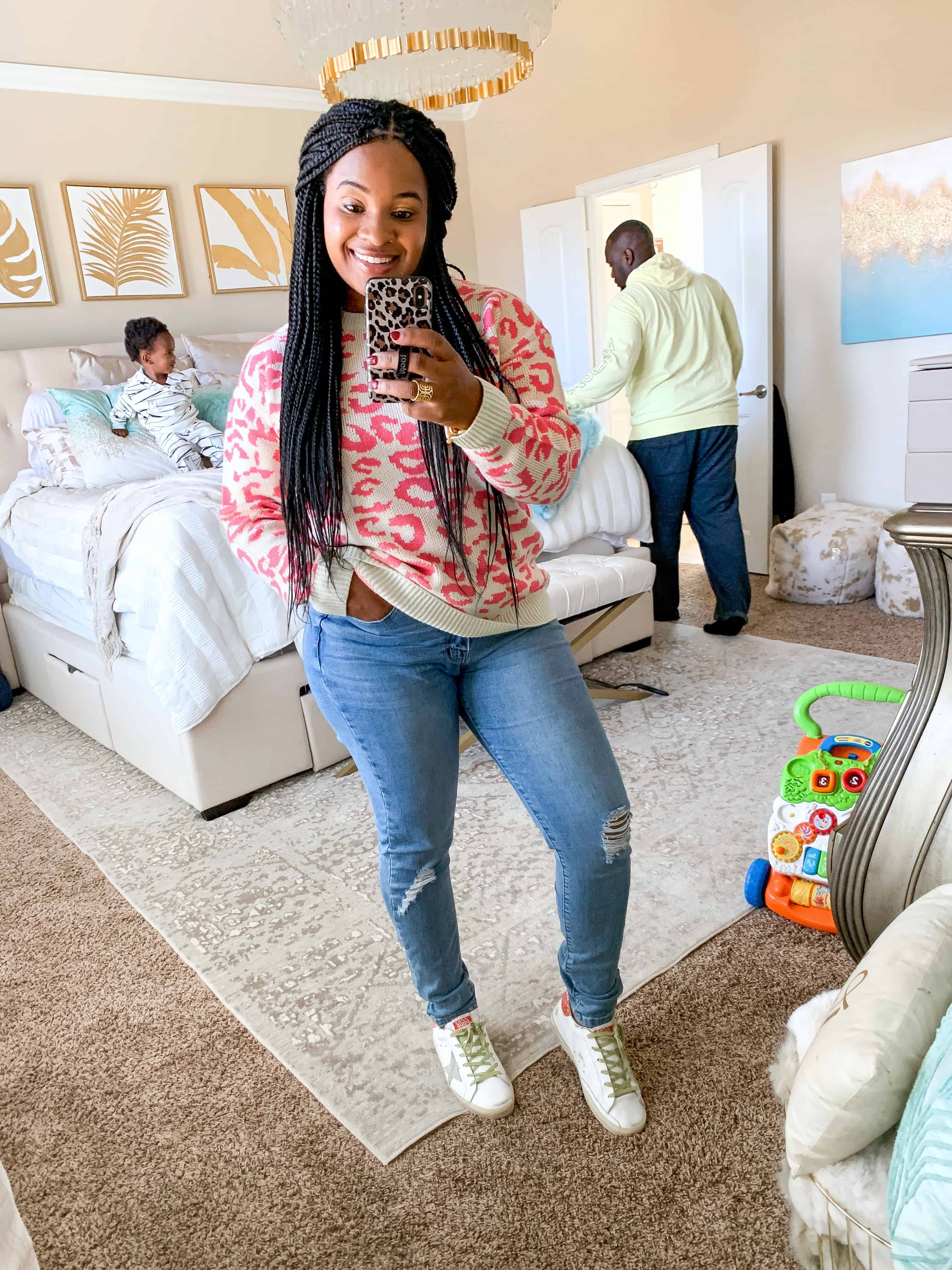 Pink Lily Boutique Fall Collection 2019 by popular fashion blog, Glamorous Versatility: image of a woman wearing a Pink Lily Get A Little Closer Hot Pink Animal Print Sweater.