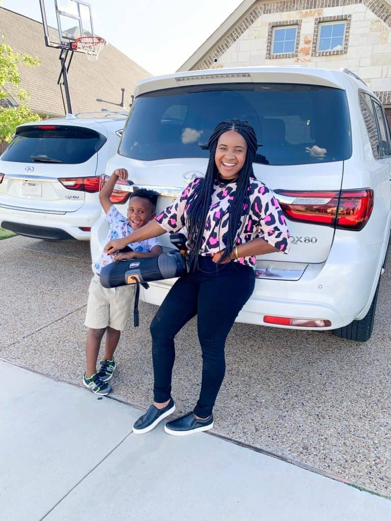 Favorite Chicco Products for Babies and Kids by popular life and style blog, Glamorous Versatility: image of a mom and son standing next to each other and holding a chicco booster.