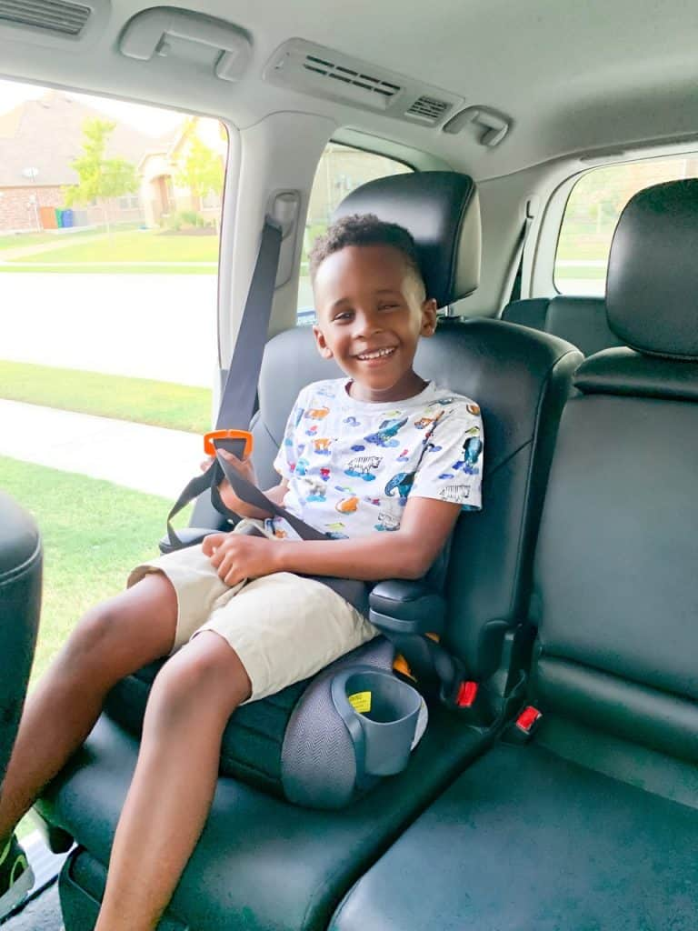 Favorite Chicco Products for Babies and Kids by popular life and style blog, Glamorous Versatility: image of a little boy sitting in a chicco booster steat.