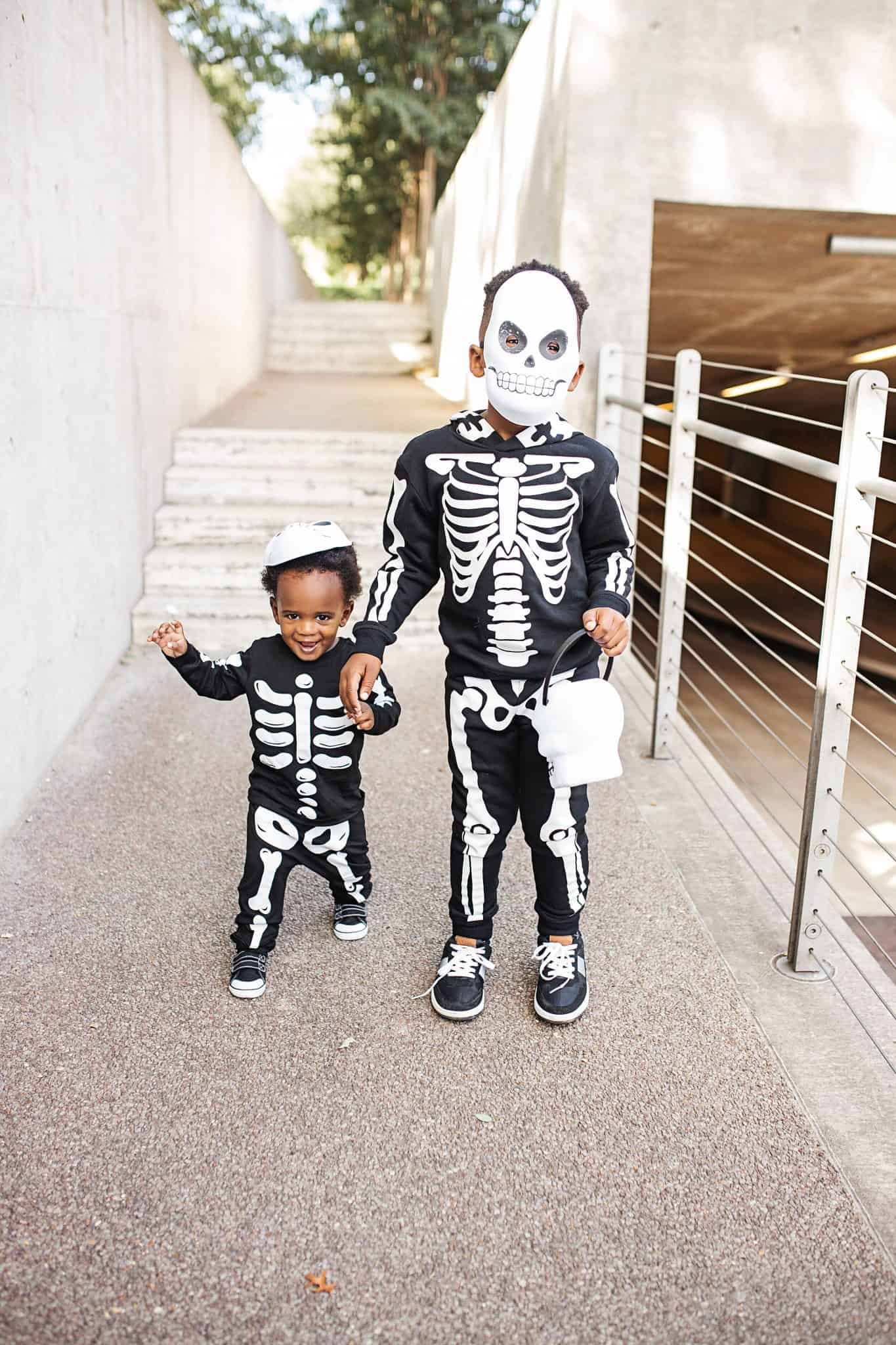 Family Halloween Costume Ideas Under $50 featured by top US life and style blog, Glamorous Versatility: image of a family wearing skeleton costumes