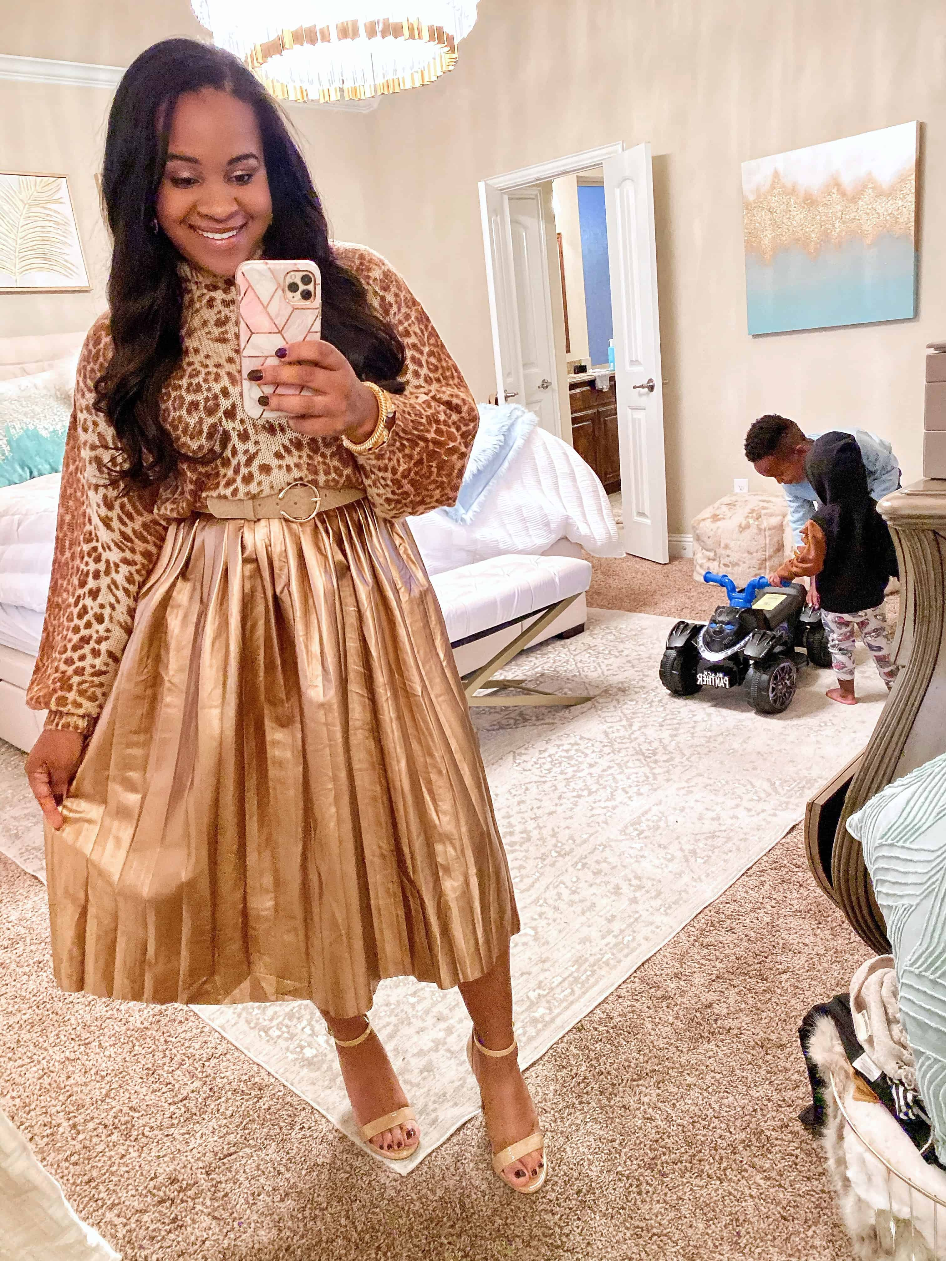 4 Cute Thanksgiving Outfit Ideas featured by top US fashion blog, Glamorous Versatility: image of a woman wearing a leopard sweater and a gold midi skirt