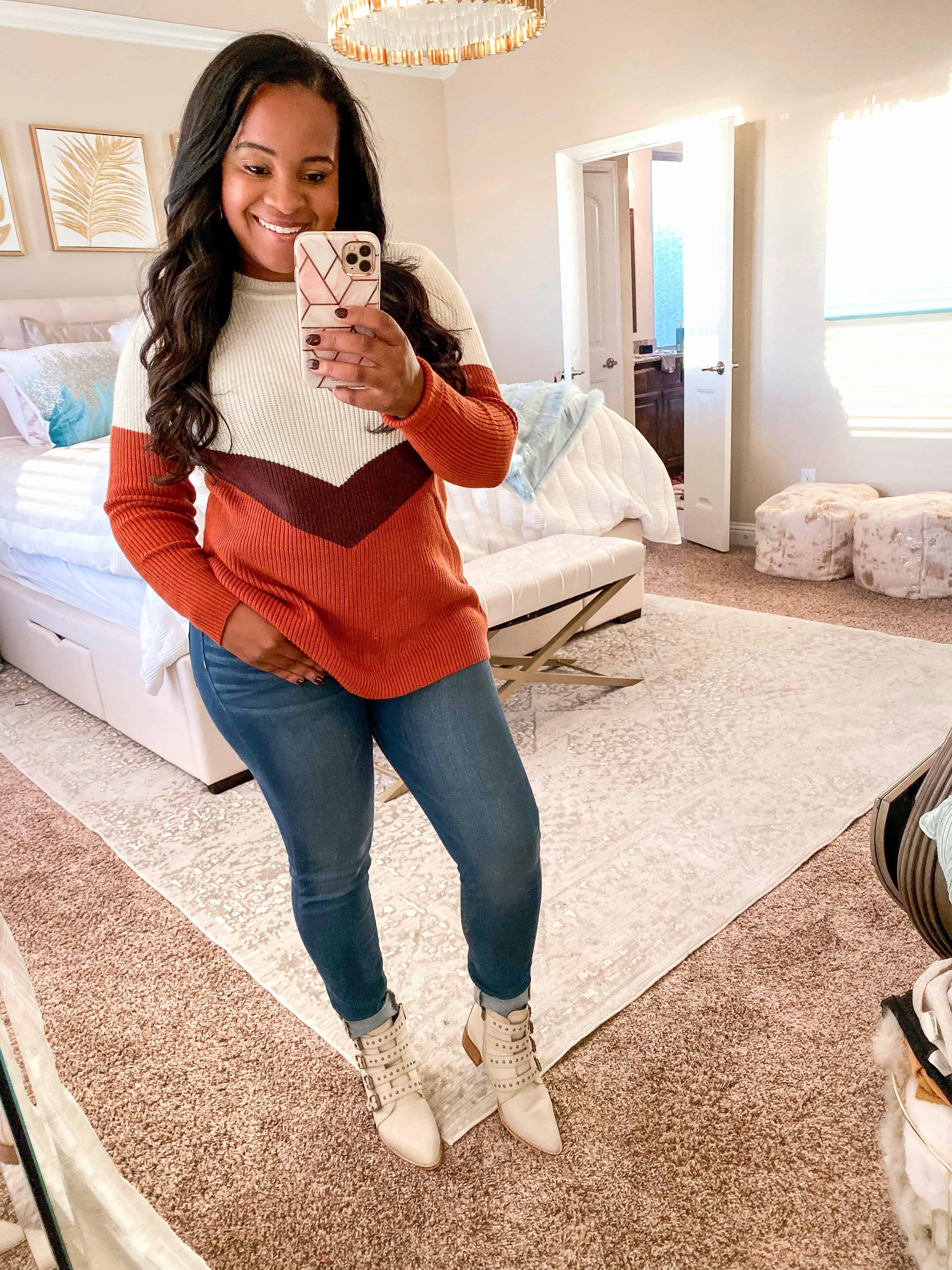 4 Cute Thanksgiving Outfit Ideas featured by top US fashion blog, Glamorous Versatility: image of a woman wearing a chevron sweater, skinny jeans and ankle booties