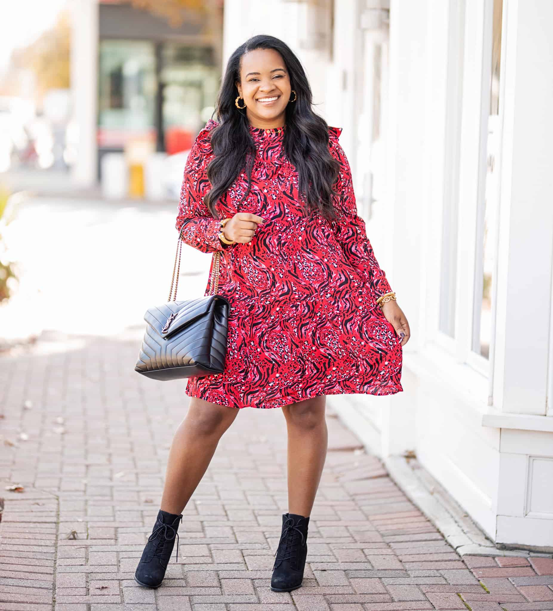 Affordable and Cute Winter Dresses for Under $25 by popular fashion blog, Glamorous Versatility: image of a woman outside wearing a Walmart Time and Tru Tiered Ruffle Dress.