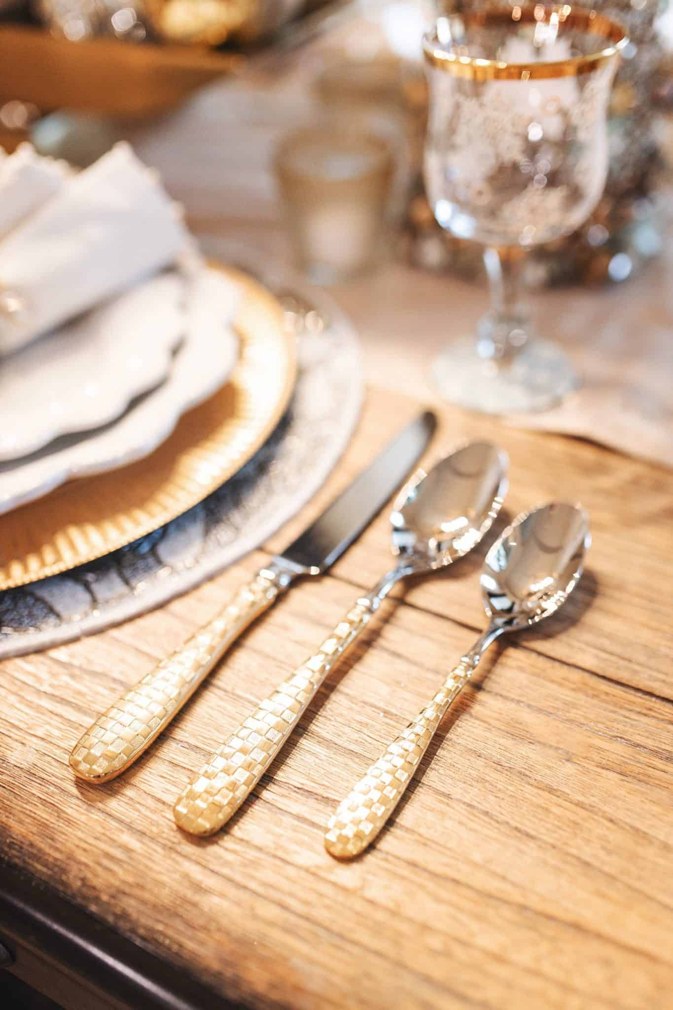 MacKenzie Childs Table Setting Ideas by popular Texas life and style blog, Glamorous Versatility: image of a table set with MacKenzie Childs Sweetbriar collection items.
