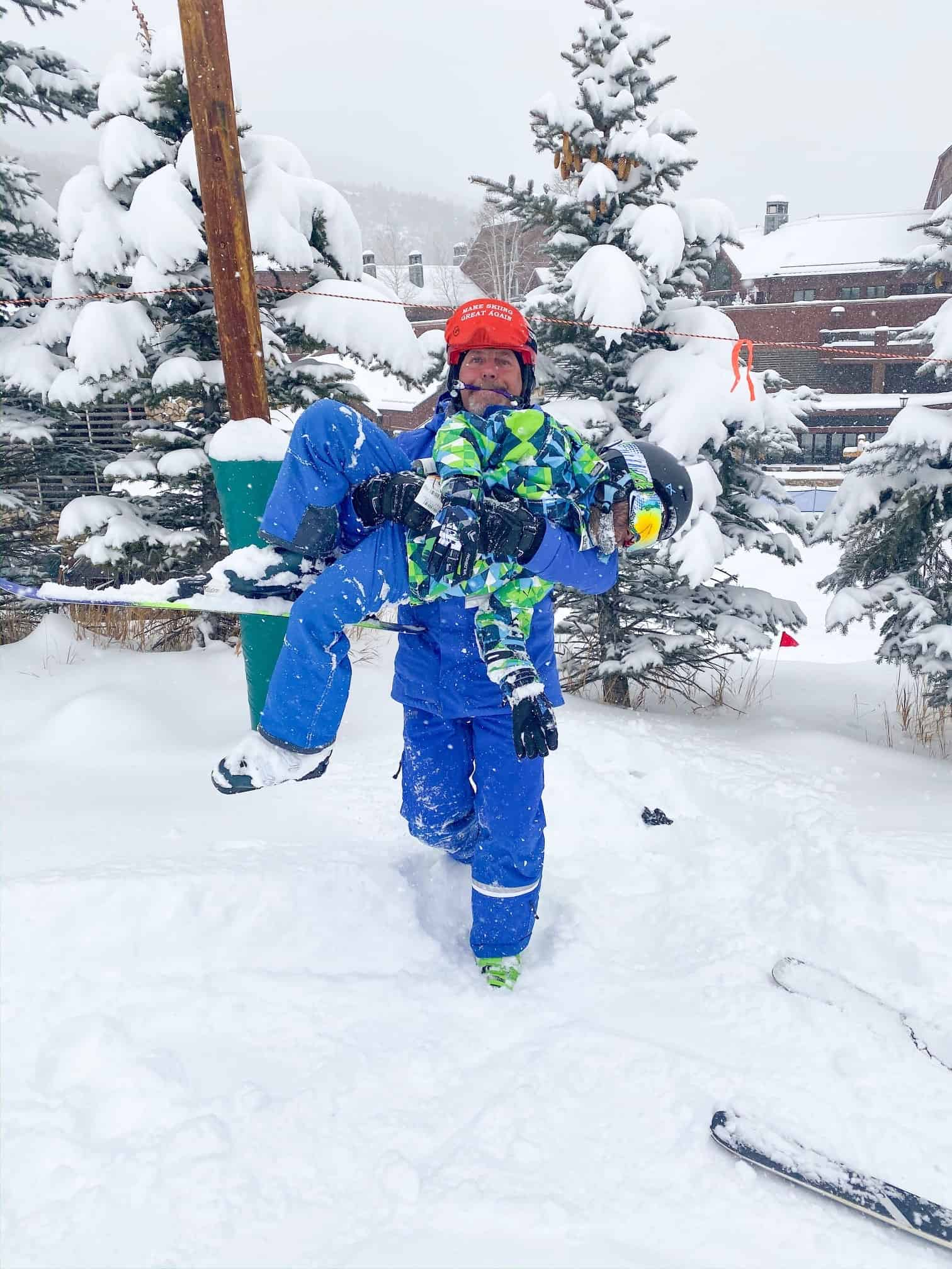 How to Plan a Ski Trip for Your Family by popular lifestyle blog, Glamorous Versatility: image of a ski instructor and a boy at Beaver Creek Ski Resort in Avon, Colorado.