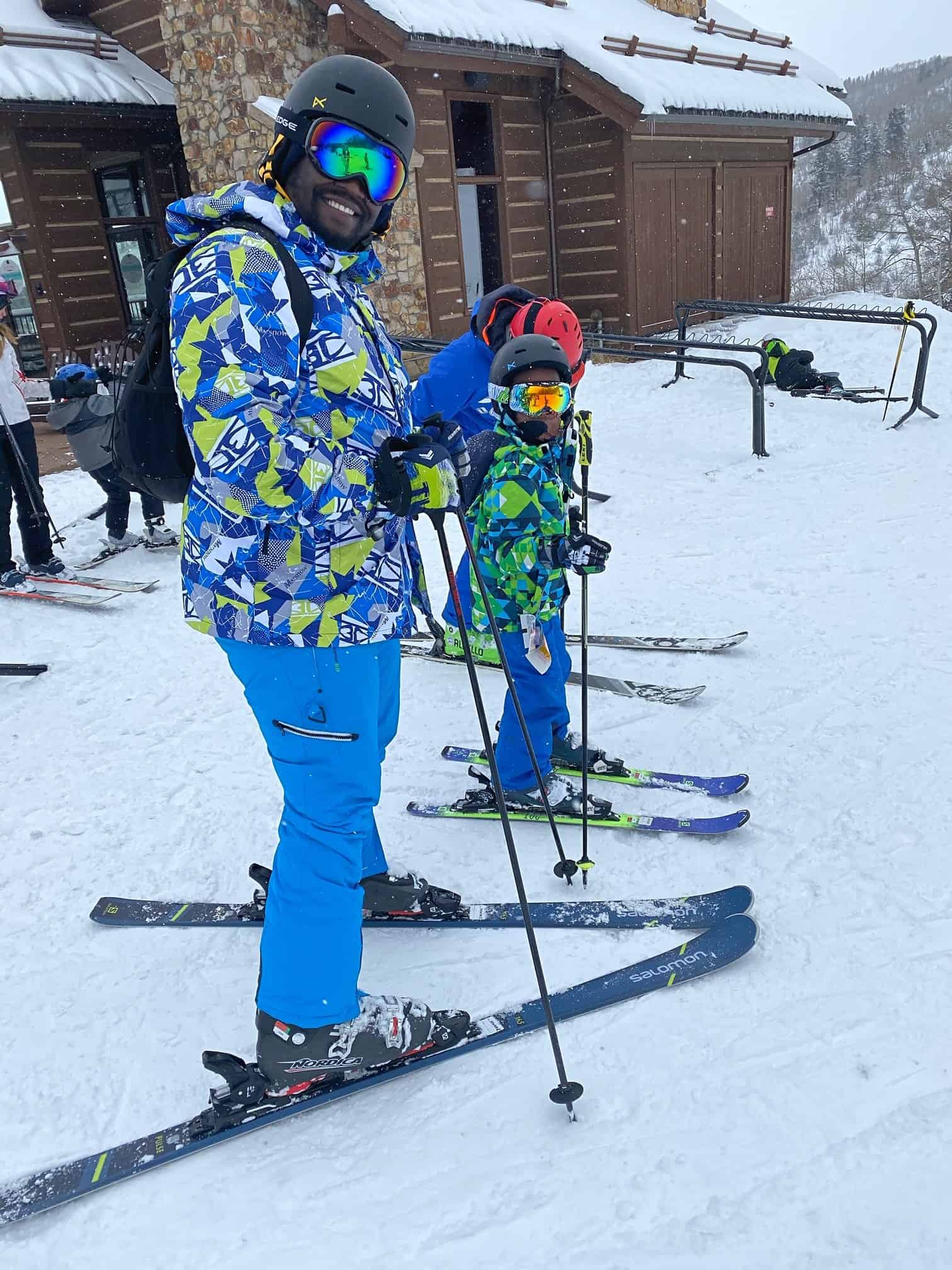 How to Plan a Ski Trip for Your Family by popular lifestyle blog, Glamorous Versatility: image of a dad and son skiing at Beaver Creek Ski Resort in Avon, Colorado.