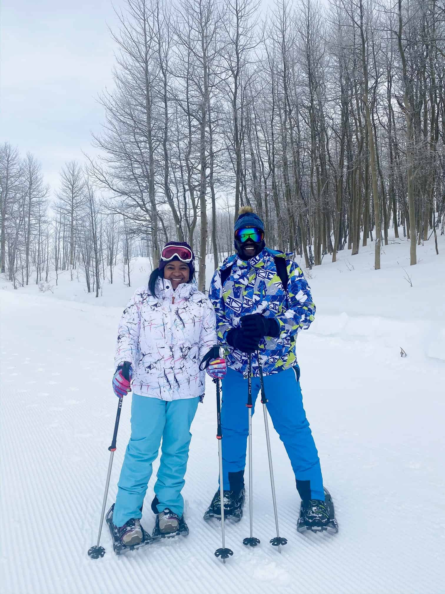 How to Plan a Ski Trip for Your Family by popular lifestyle blog, Glamorous Versatility: image of a husband and wife skiing at Beaver Creek Ski Resort in Avon, Colorado.