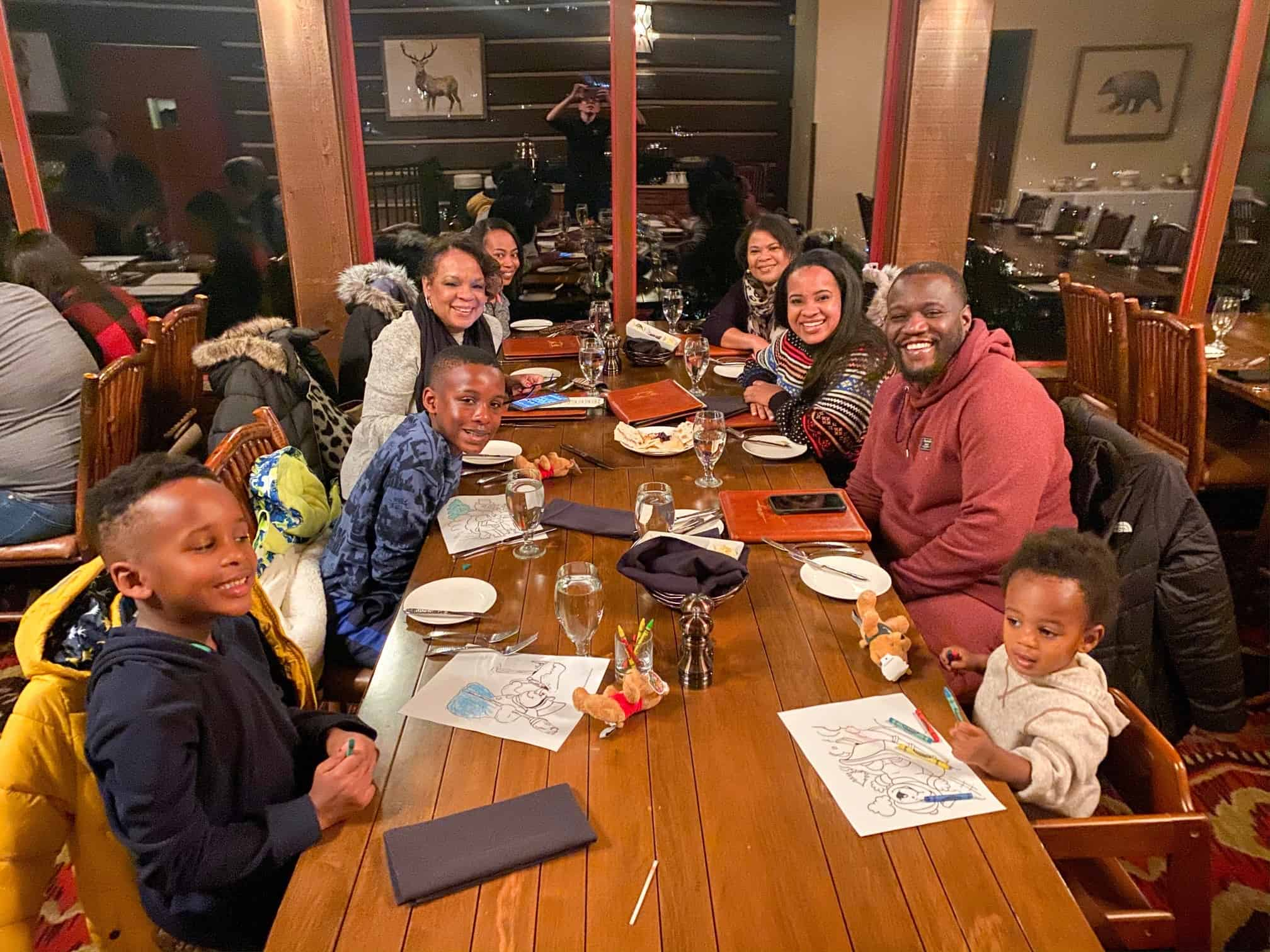 How to Plan a Ski Trip for Your Family by popular lifestyle blog, Glamorous Versatility: image of a family dining at Beaver Creek Ski Resort in Avon, Colorado.