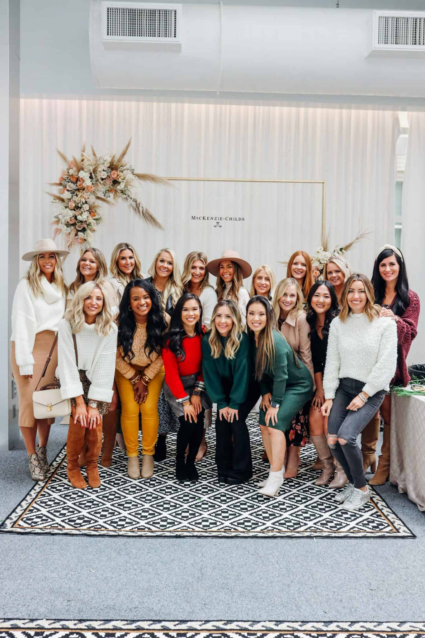 MacKenzie Childs Table Setting Ideas by popular Texas life and style blog, Glamorous Versatility: image of Texas bloggers at a MacKenzie Childs event.