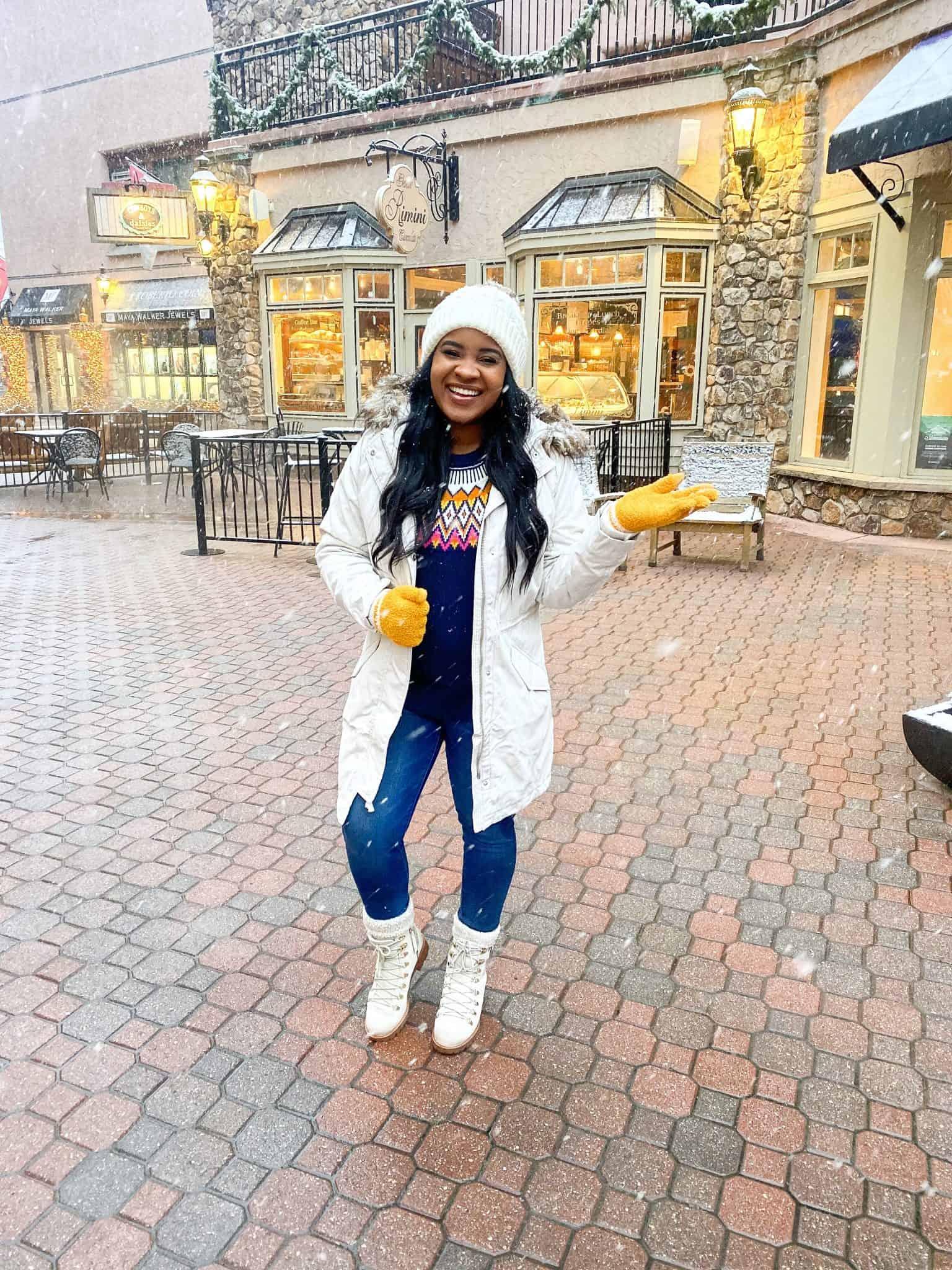 Family Ski Trip Packing List by popular Dallas travel blog, Glamorous Versatility: image of a woman standing outside at Beaver Creek ski resort.