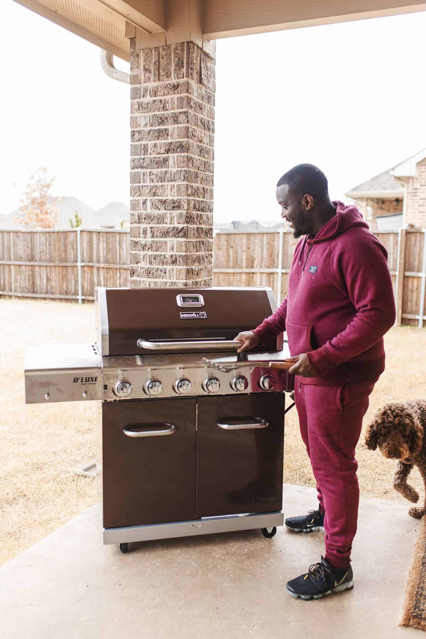 Home Depot Valentine's Day Gifts for Him by popular Dallas lifestyle blog, Glamorous Versatility: image of a man opening a Nexgrill BBQ.