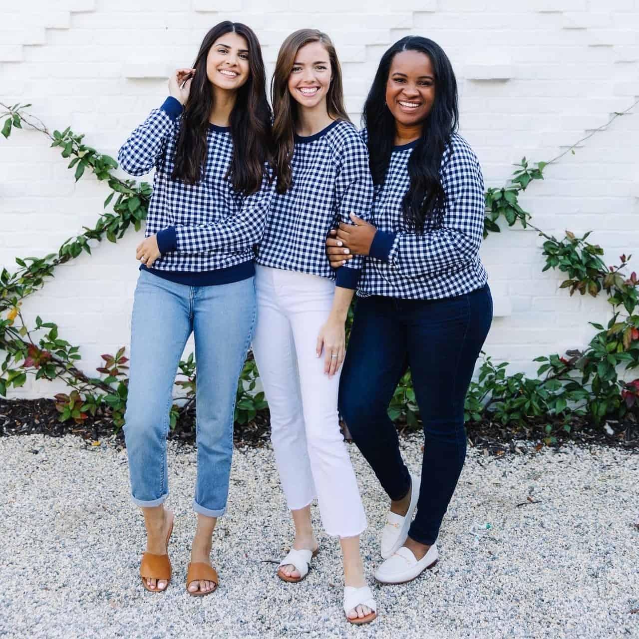 Behind The Scenes Draper James Trip by popular Dallas fashion blog, Glamorous Versatility: image of a three women wearing a Draper James blue gingham sweatshirts at The Park on Saint Simons Island.