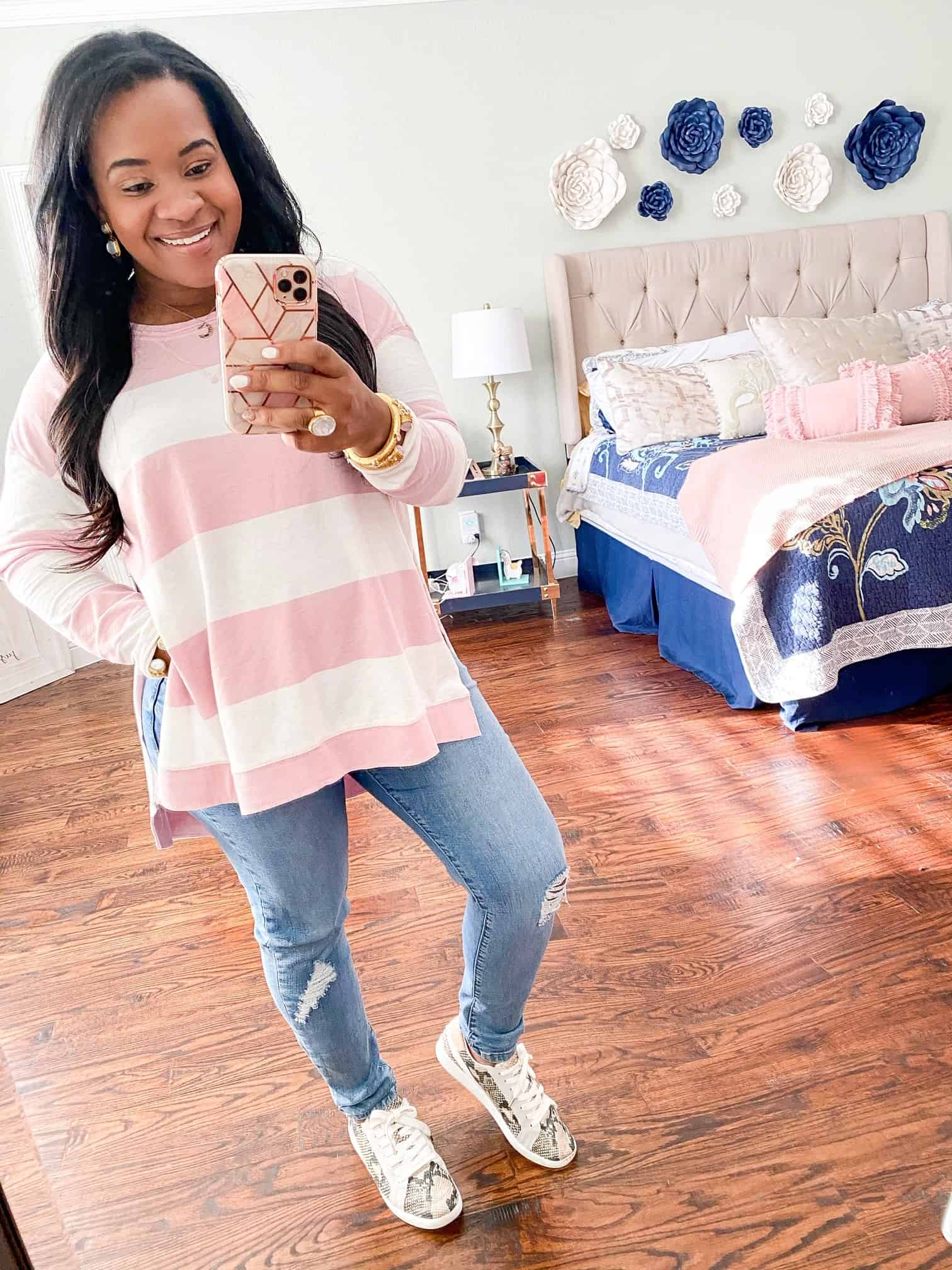 Red Dress Boutique Pink Hue Try-On by popular Dallas fashion blog, Glamorous Versatility: image of a woman wearing a Red Dress Boutique The Pale Blush Rugby Stripe Weekender Sweater Z SUPPLY and Red Dress Boutique Find Me In LA Light Wash Distressed Skinny Jeans.