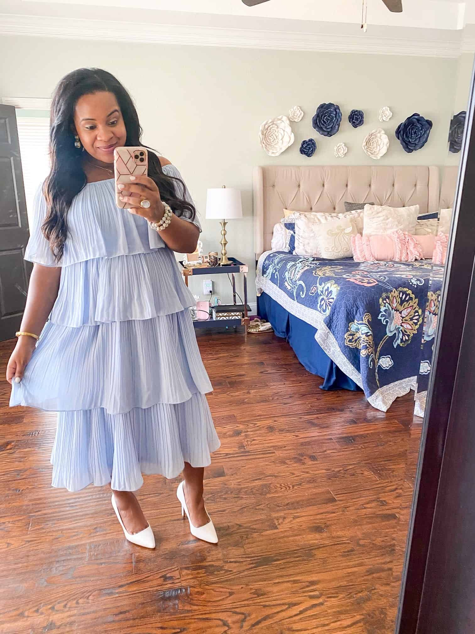 Baby Shower Dress Ideas by popular Dallas fashion blog, Glamorous Versatility: image of a woman wearing a blue tiered midi dress.