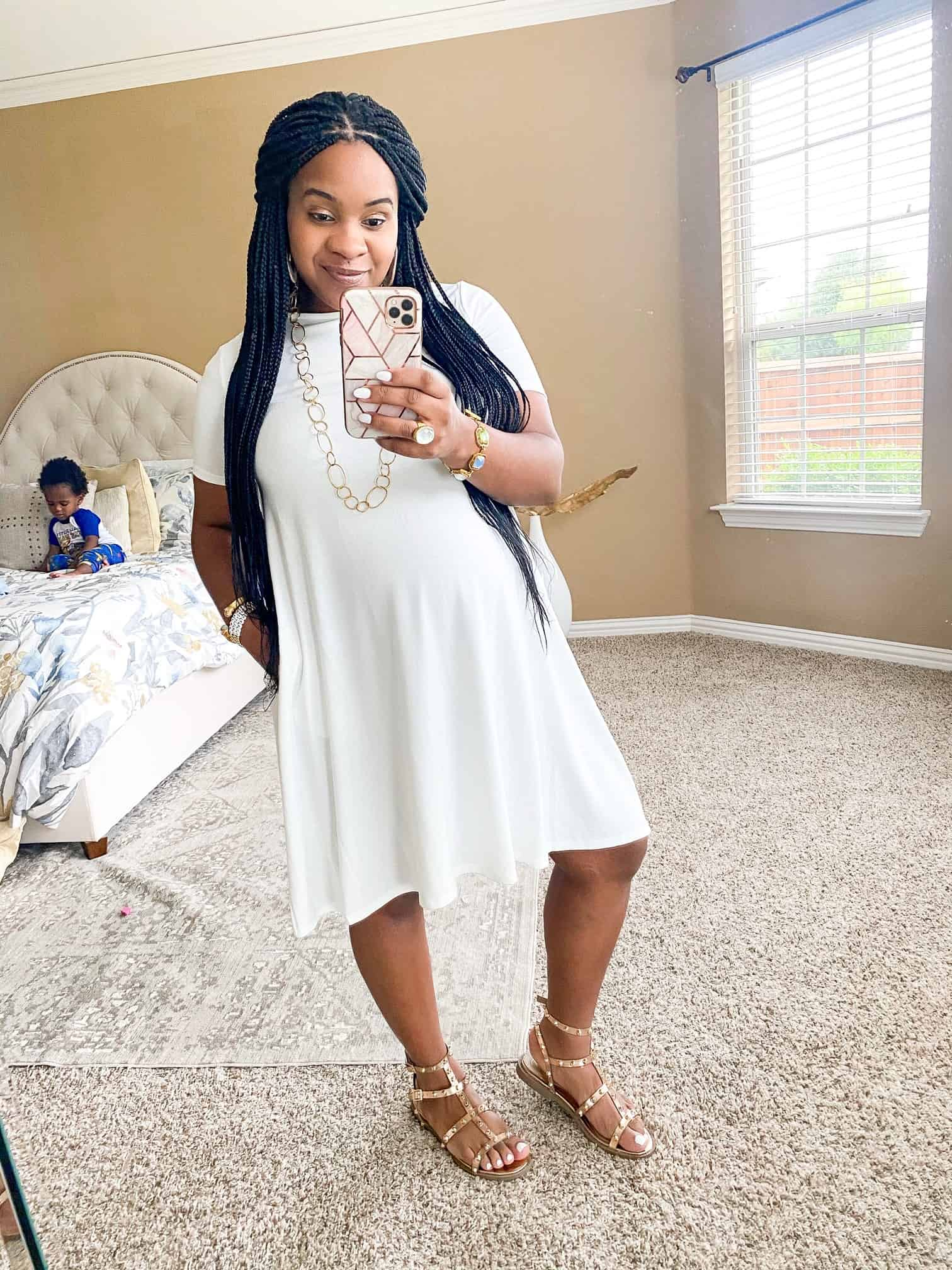 Maternity Dresses by popular Dallas fashion blog, Glamorous Versatility: image of a woman wearing a Pink Blush Ivory Solid Short Sleeve Maternity Swing Dress.