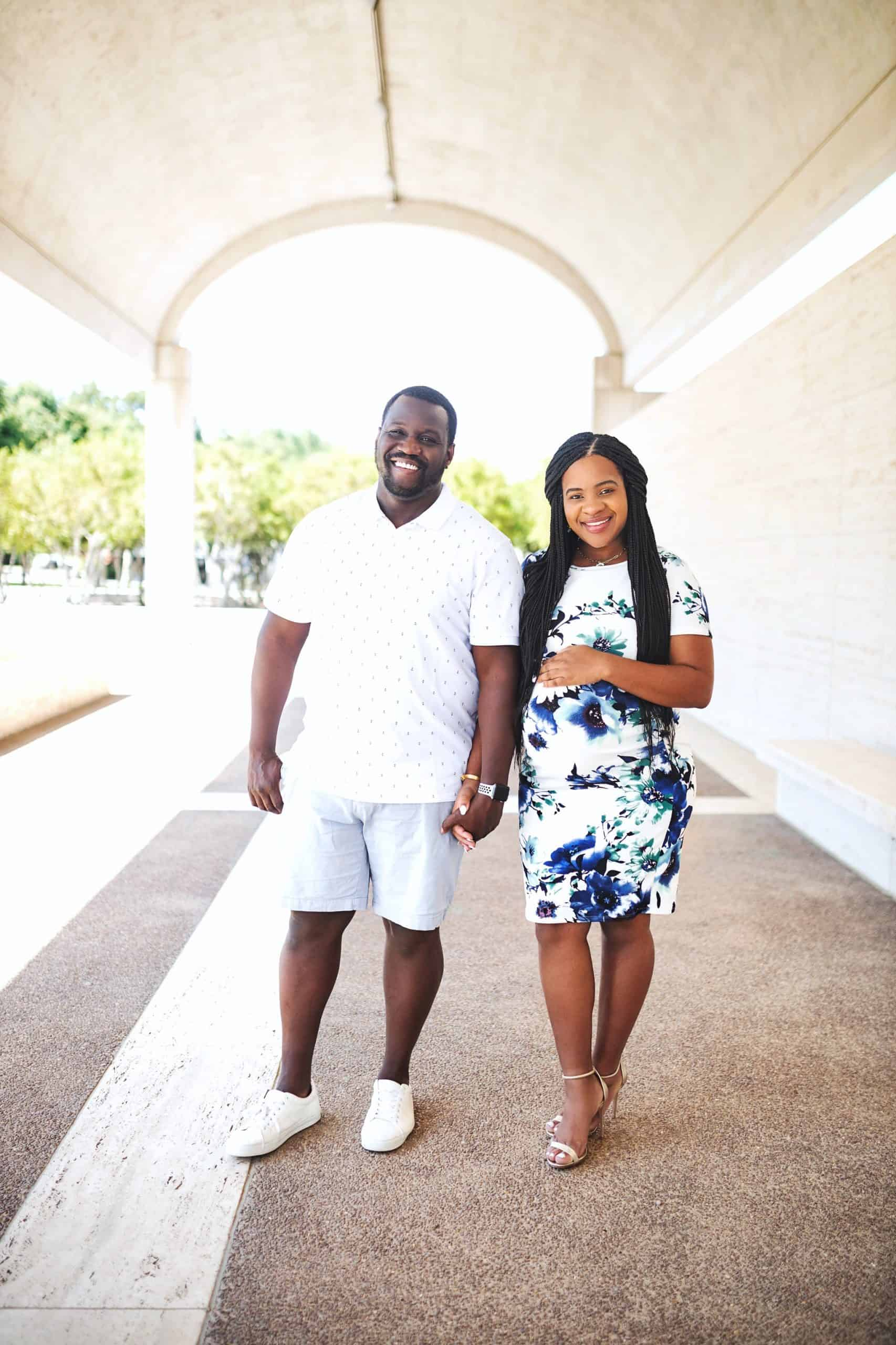 Home Building Tips by popular Dallas lifestyle blog, Glamorous Versatility: image of a husband and pregnant wife standing together and holding hands.