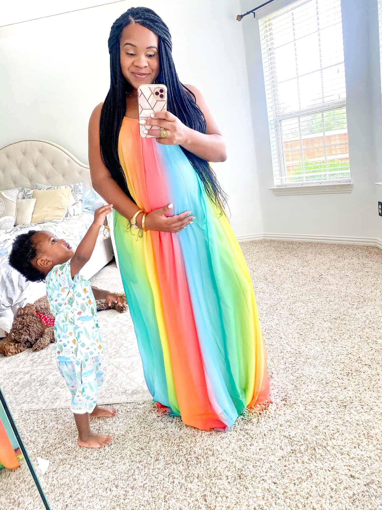 Maxi Dresses by popular Dallas fashion blog, Glamorous Versatility: image of a woman wearing a Red Dress Forever Better Rainbow Maxi Dress AURA.