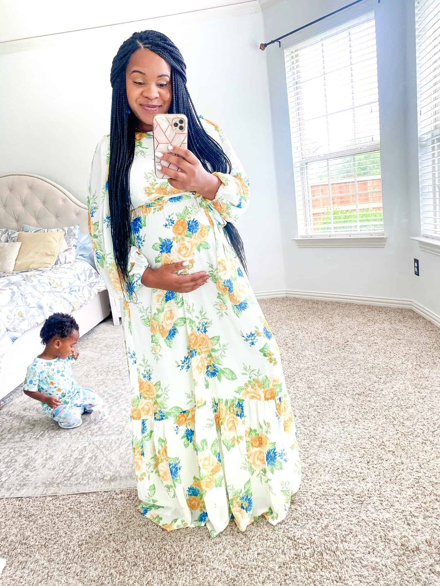 Maxi Dresses by popular Dallas fashion blog, Glamorous Versatility: image of a woman wearing a Red Dress Blooms Of You Ivory Floral Print Maxi Dress.
