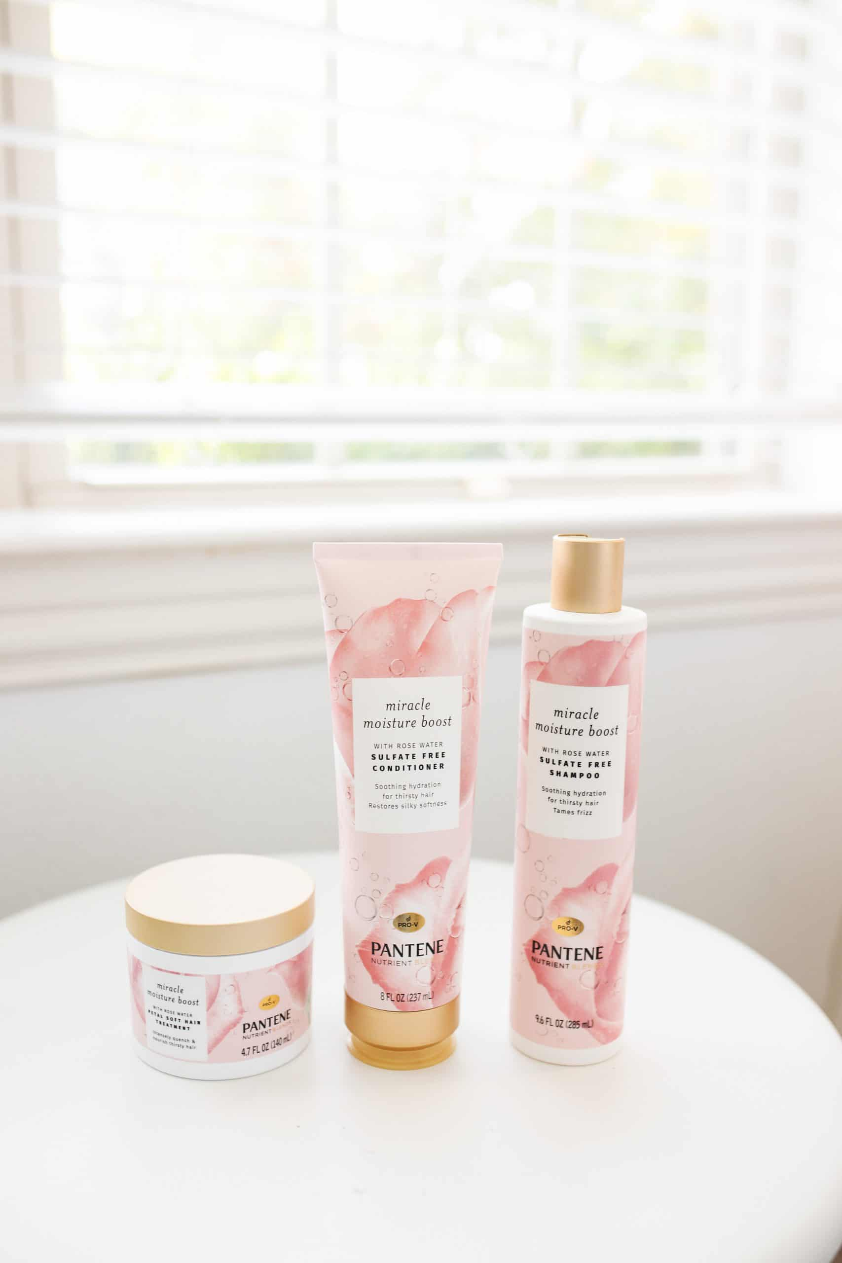 Self Confidence Tips by popular Dallas lifestyle blog, Glamorous Versatility: image of Pantene Miracle Moisture Boost Shampoo, Pantene Miracle Moisture Boost conditioner, and Pantene Miracle Moisture Boost Petal Soft Hair Treatment.