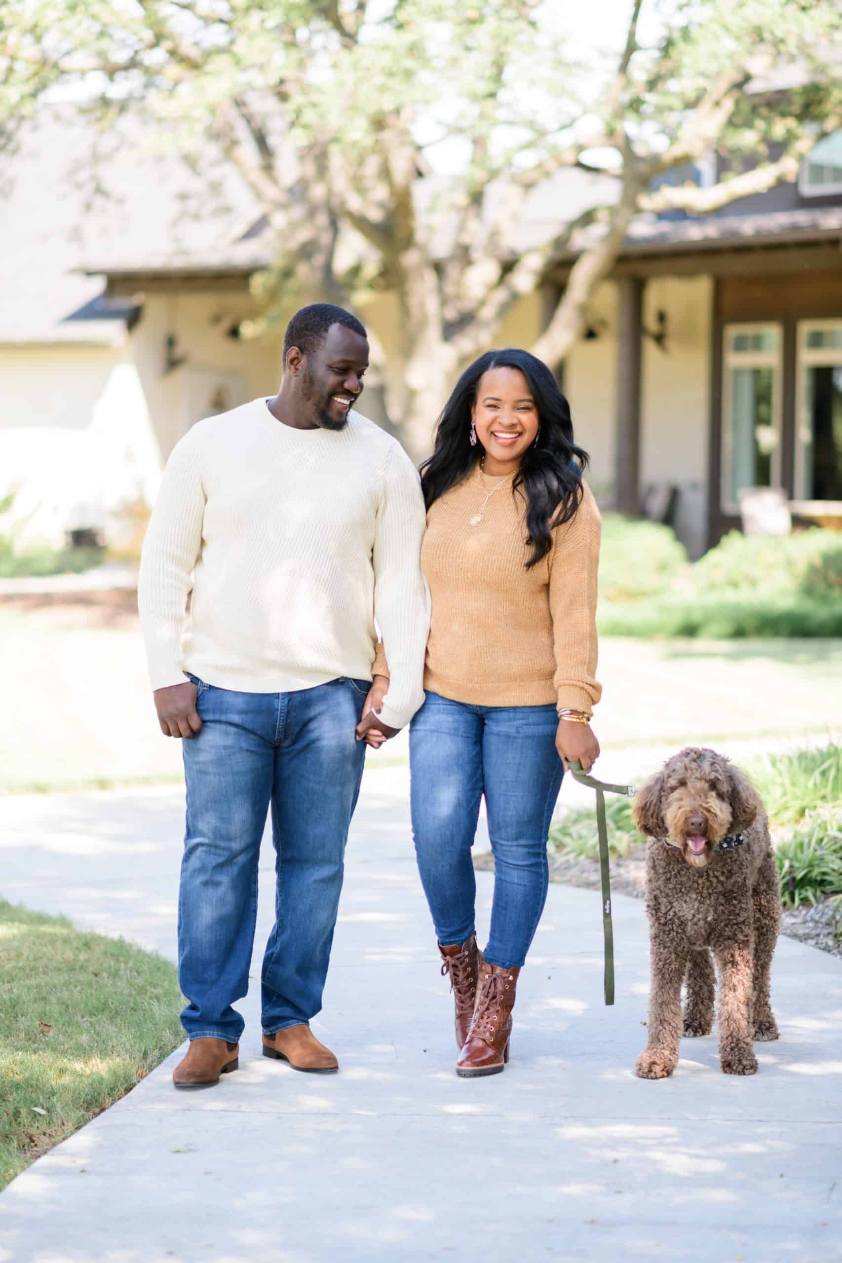 Gifts for Him by popular Dallas life and style blog, Glamorous Versatility: image of husband and wife taking their dog for a walk.