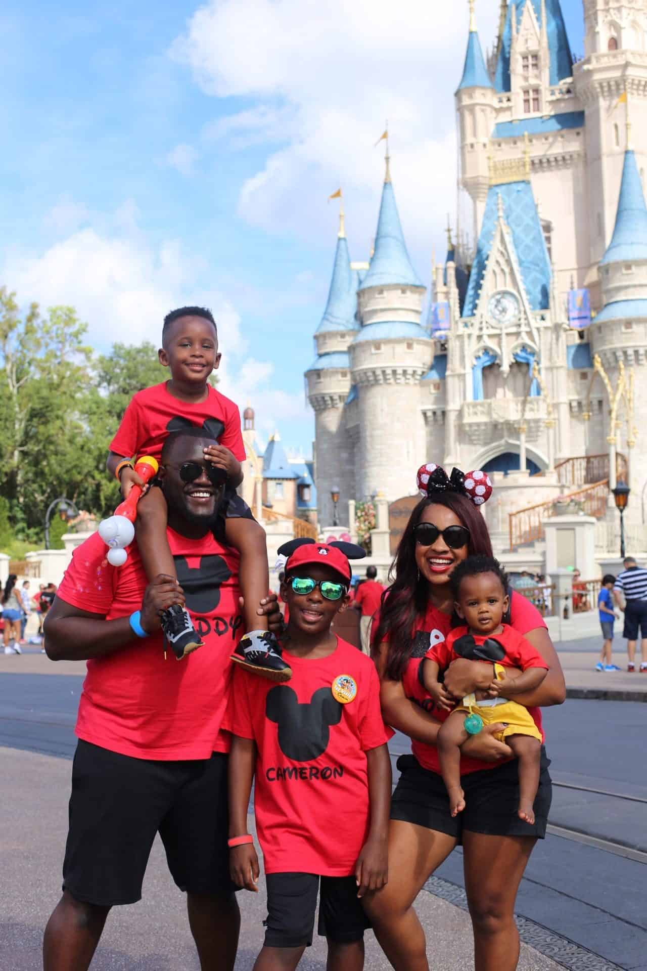 Etsy Favorites by popular Dallas life and style blog, Glamorous Versatility: image of a family wearing matching Mickey Mouse shirts and standing n front of Cinderella's castle at Disney World.
