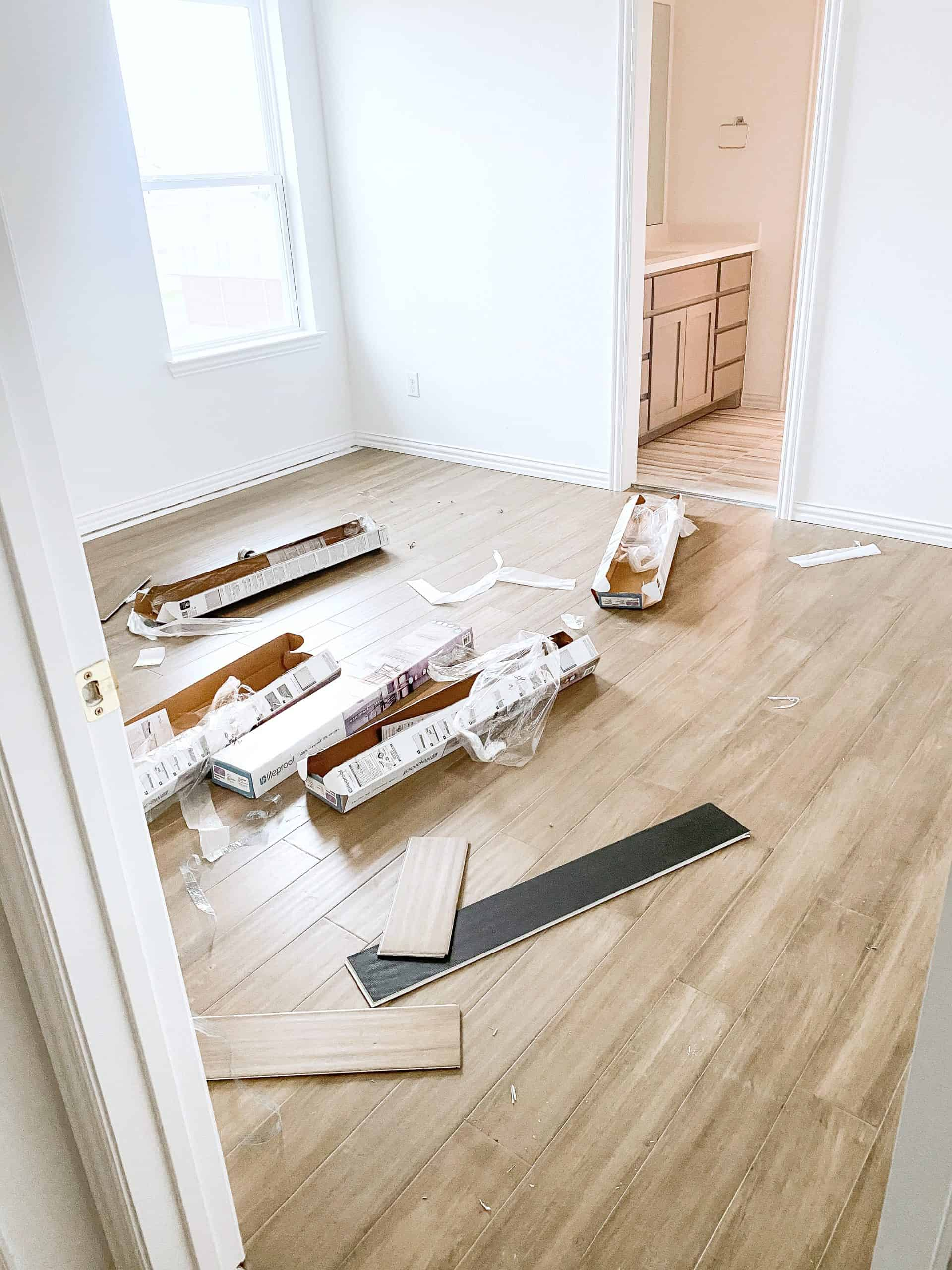Wood Floor Installation by popular Dallas life and style blog, Glamorous Versatility: image of light wood floors being installed in a boy's room.