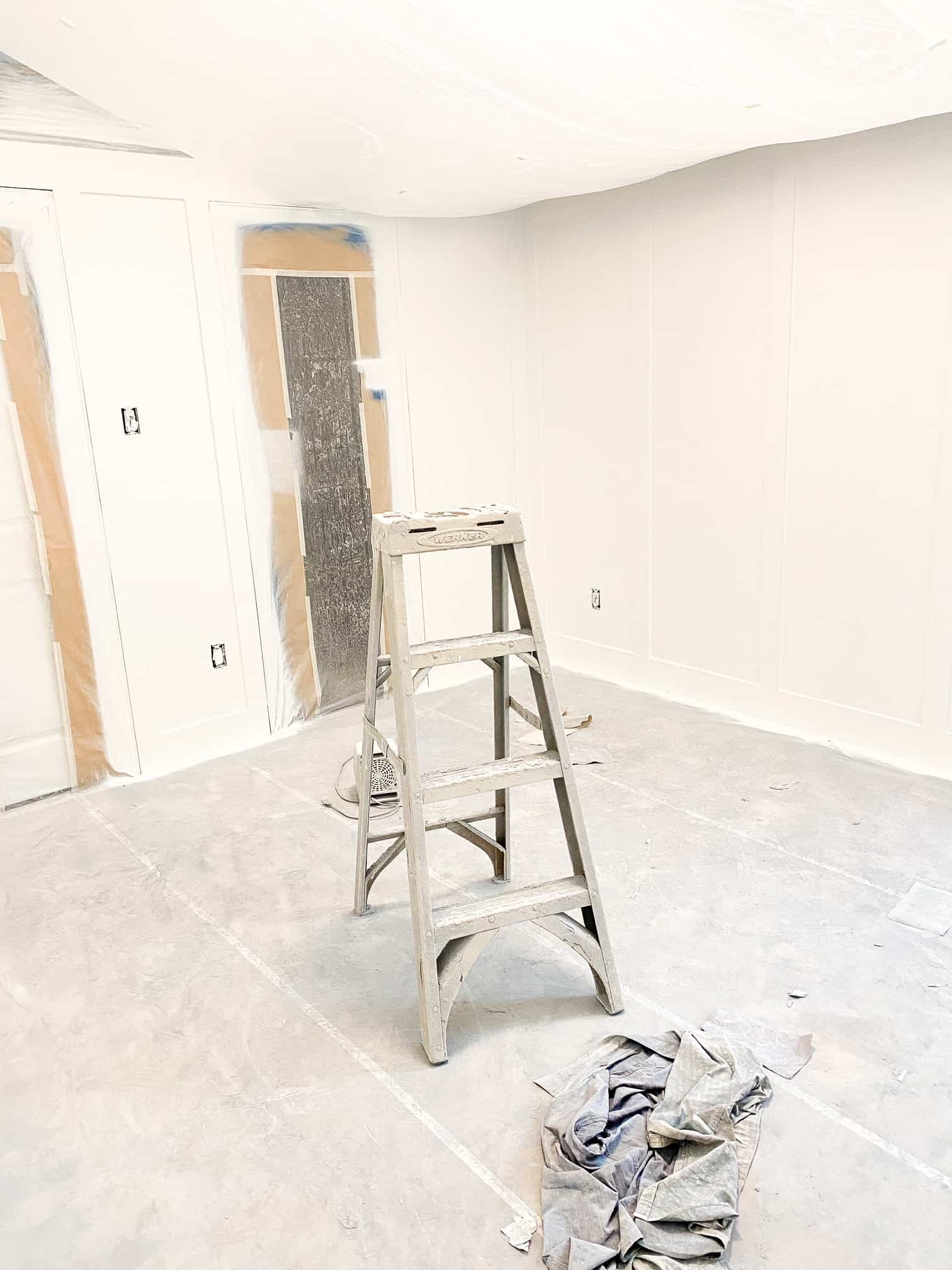 Bedroom Paint Colors by popular Dallas life and style blog, Glamorous Versatility: image of a unfinished bedroom with a step ladder in the middle of the floor.